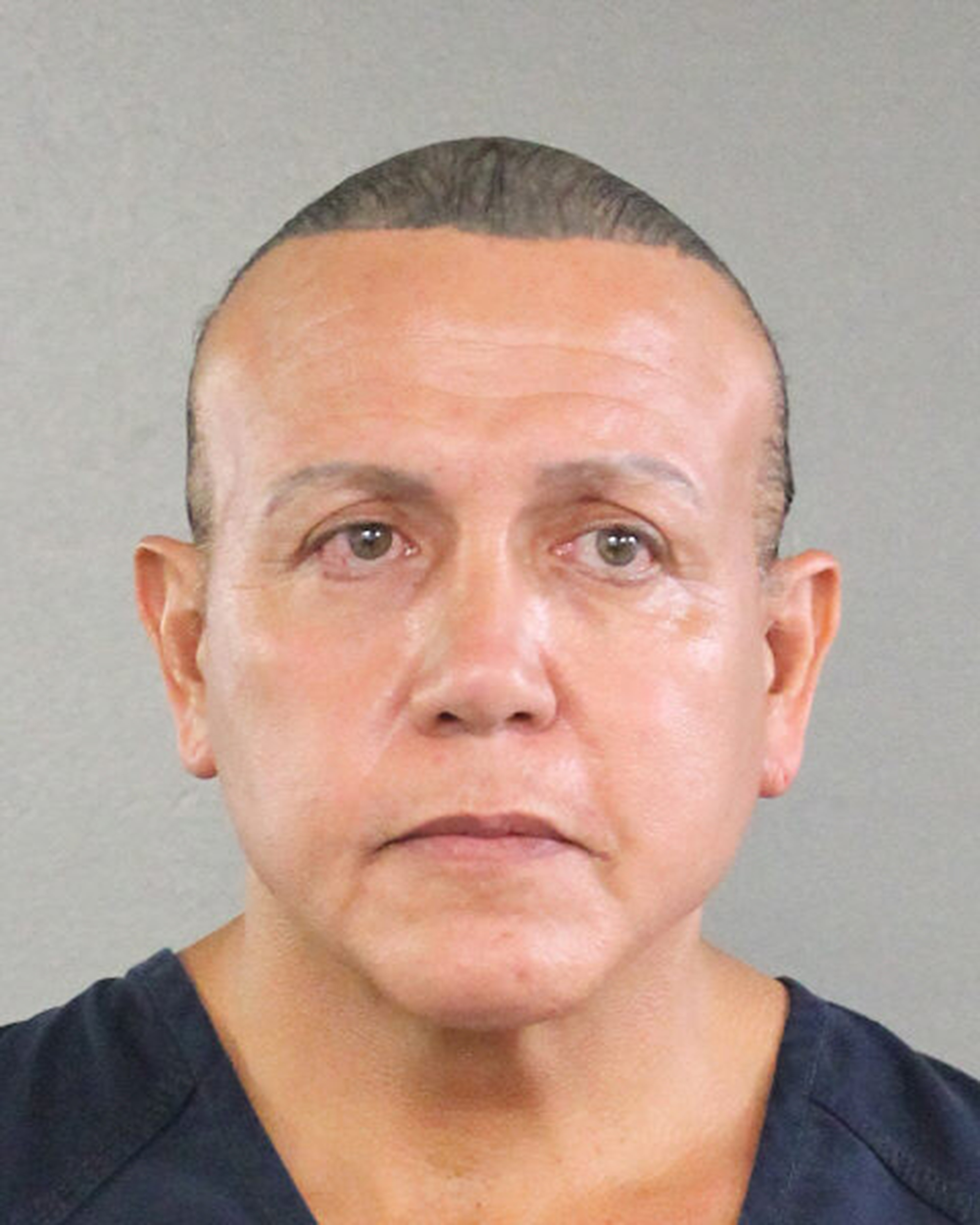 In this undated handout provided by the Broward County Sheriff's Office, Cesar Sayoc poses for a mugshot photo in Miami, Florida.