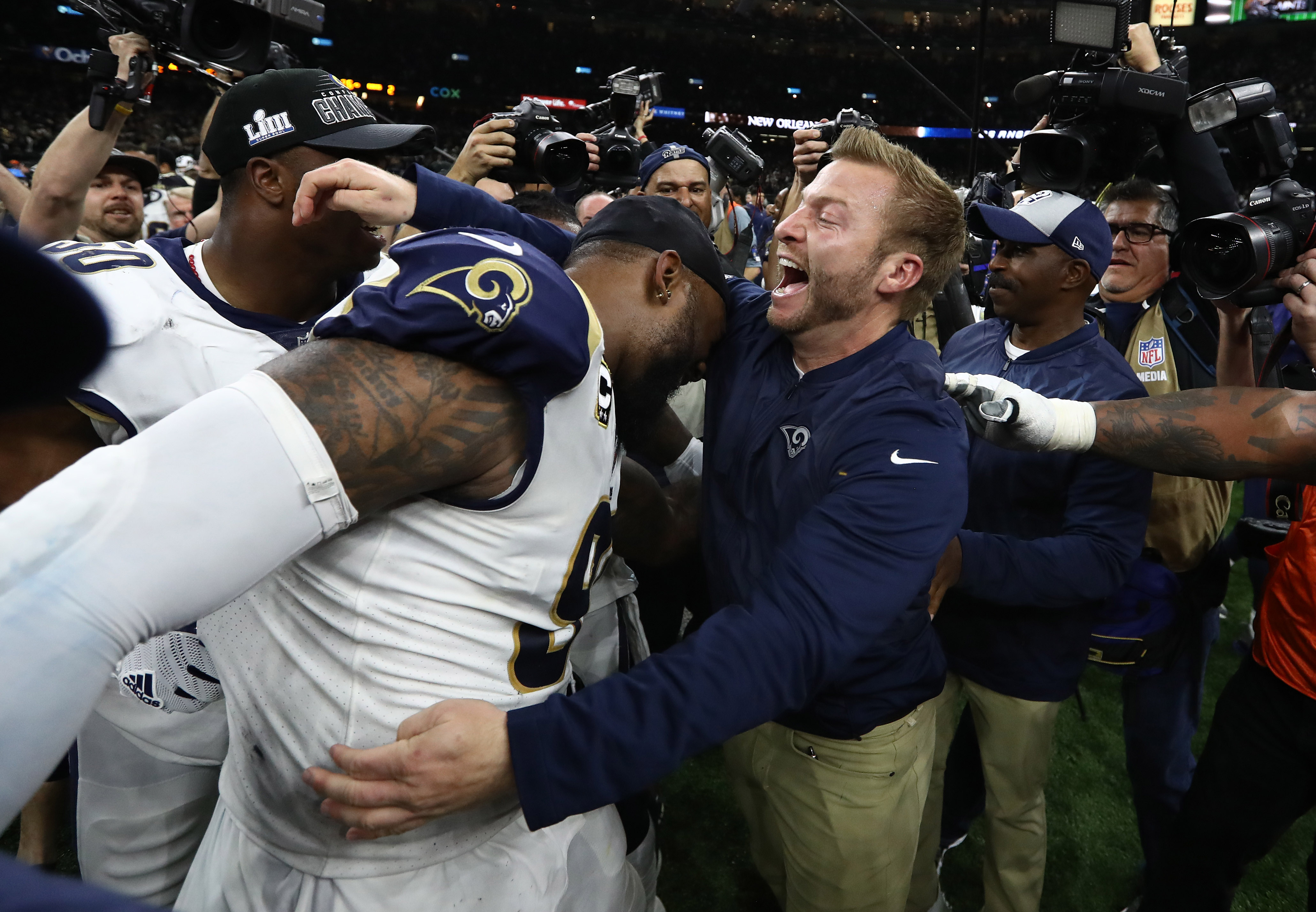 Los Angeles Rams HC Sean McVay celebrates with DT Michael Brockers after winning the NFC Championship game against the New Orleans Saints, Jan. 20, 2019.