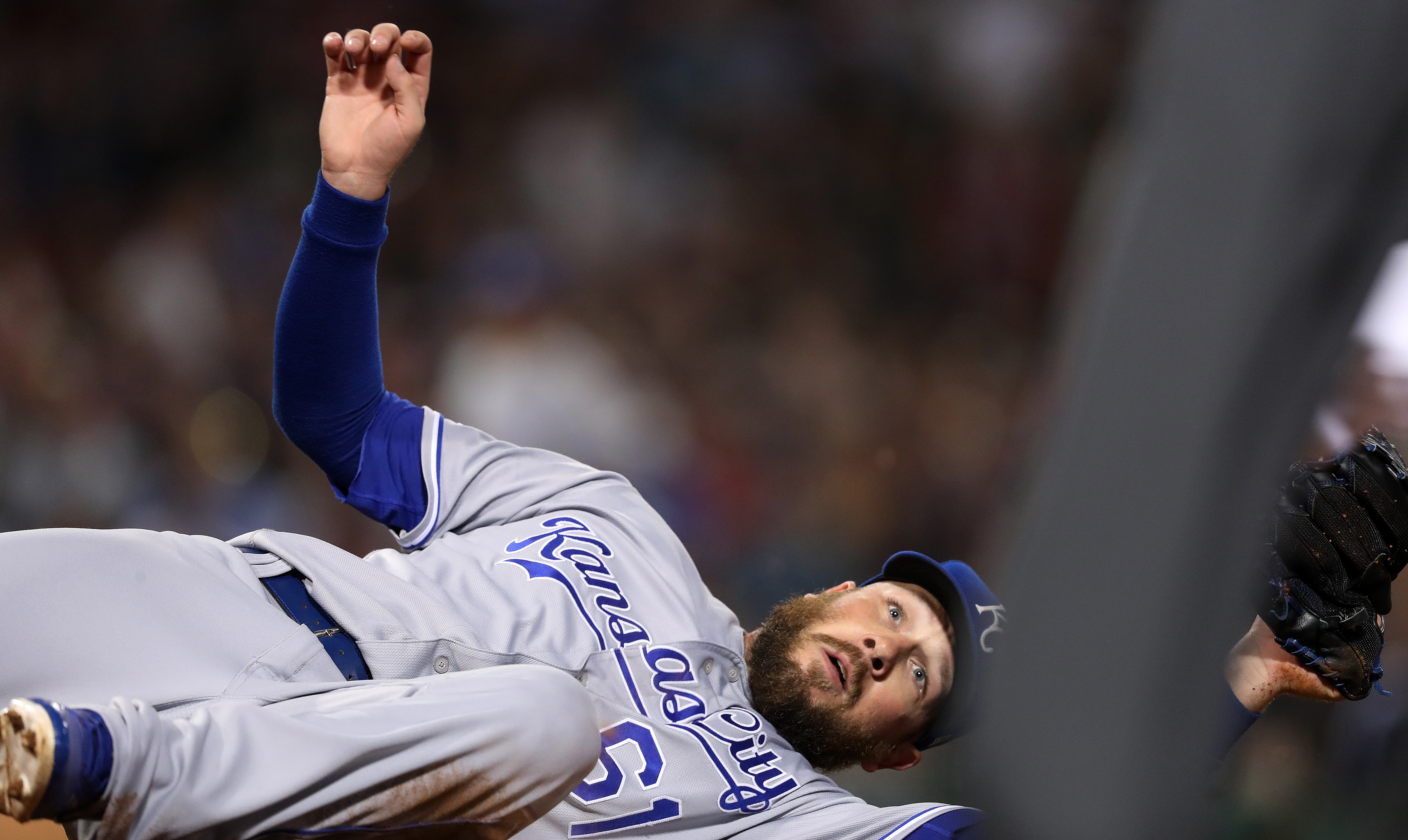 Kansas City Royals pitcher Kevin McCarthy looks for the umpire's call as he covered first base and fell, but got the out on Red Sox center fielder Jackie Bradley Jr. to end the sixth inning. The Boston Red Sox host the Kansas City Royals in a regular seas