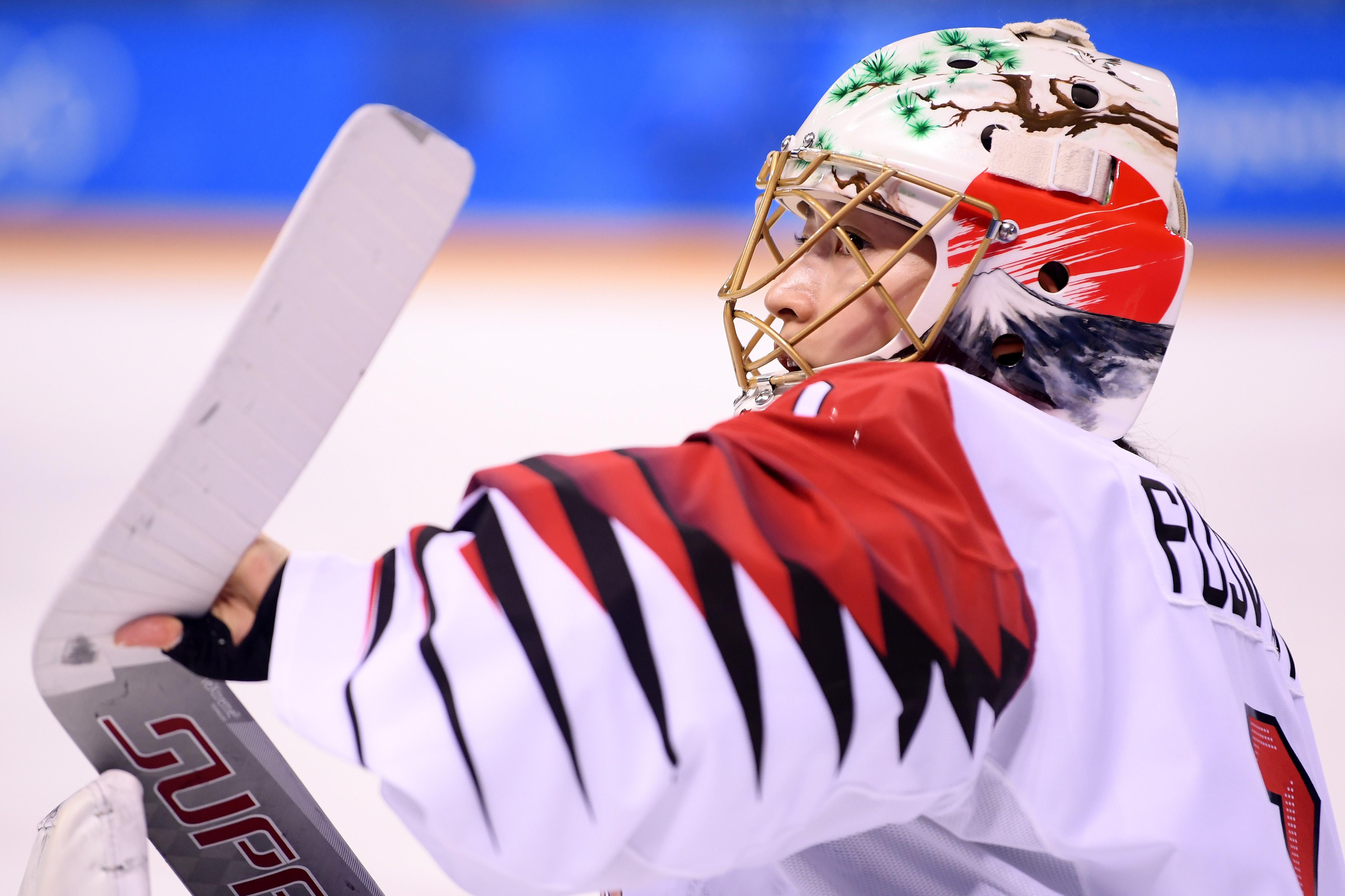 Nana Fujimoto #1 of Japan looks on in the third period against Switzerland during the Women's Ice Hockey Classification game