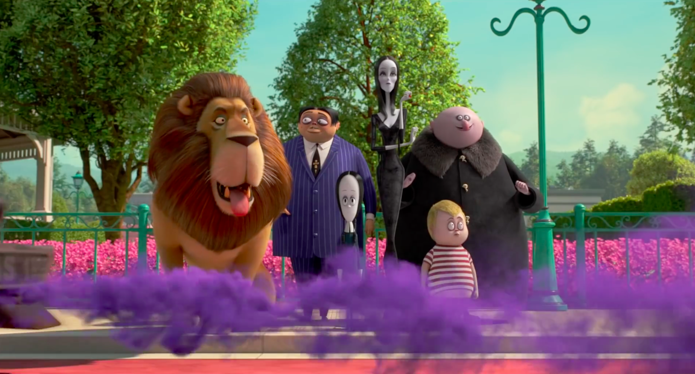 A lion, a short dark-haired and wide-set man, a tall, impossibly skinny woman, a girl with an unusually large forehead, a short, stout boy with blonde hair, and a stout bald man stand on a sidewalk in front of a park. There is purple smoke in front of the
