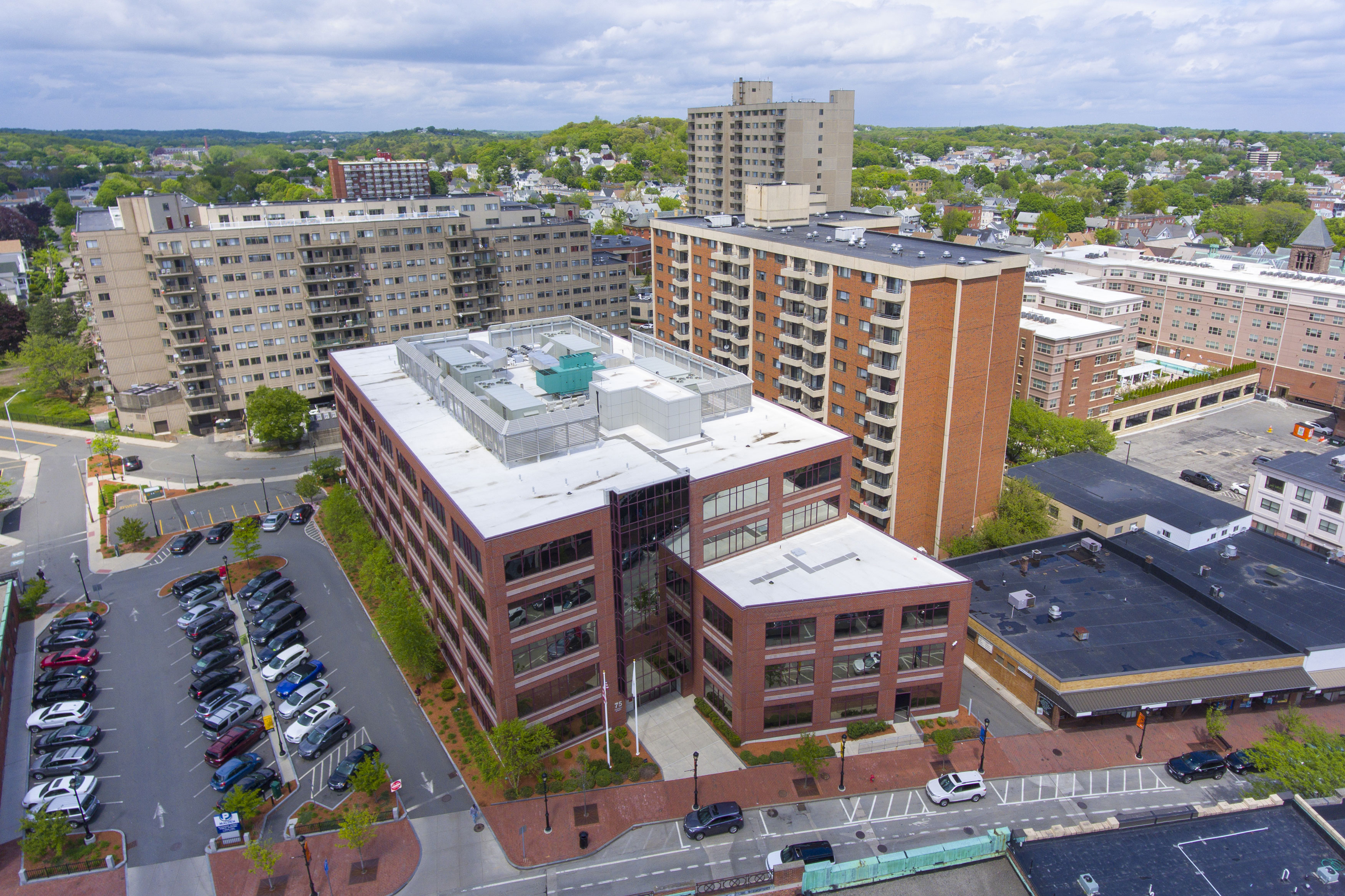 An aerial view of apartment buildings and parking lots in Malden, Massachusetts.