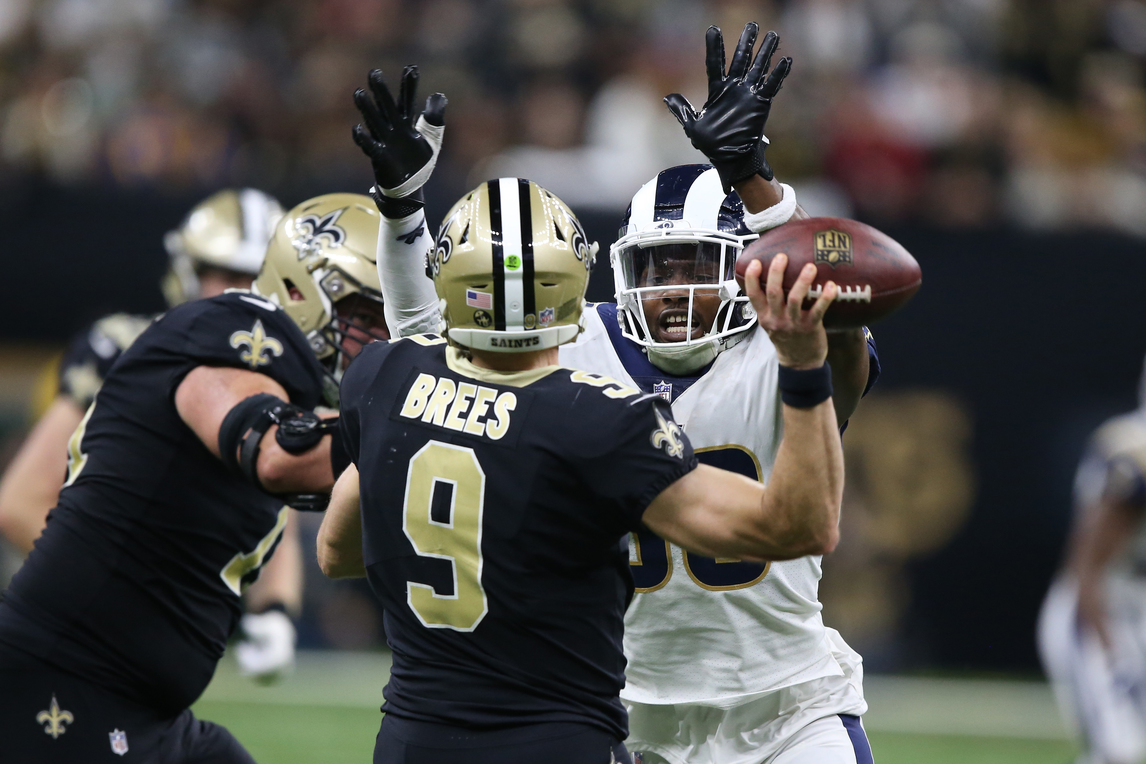 Los Angeles Rams EDGE Dante Fowler, Jr., pressures New Orleans Saints QB Drew Brees during overtime of the NFC Championship, Jan. 20, 2019.