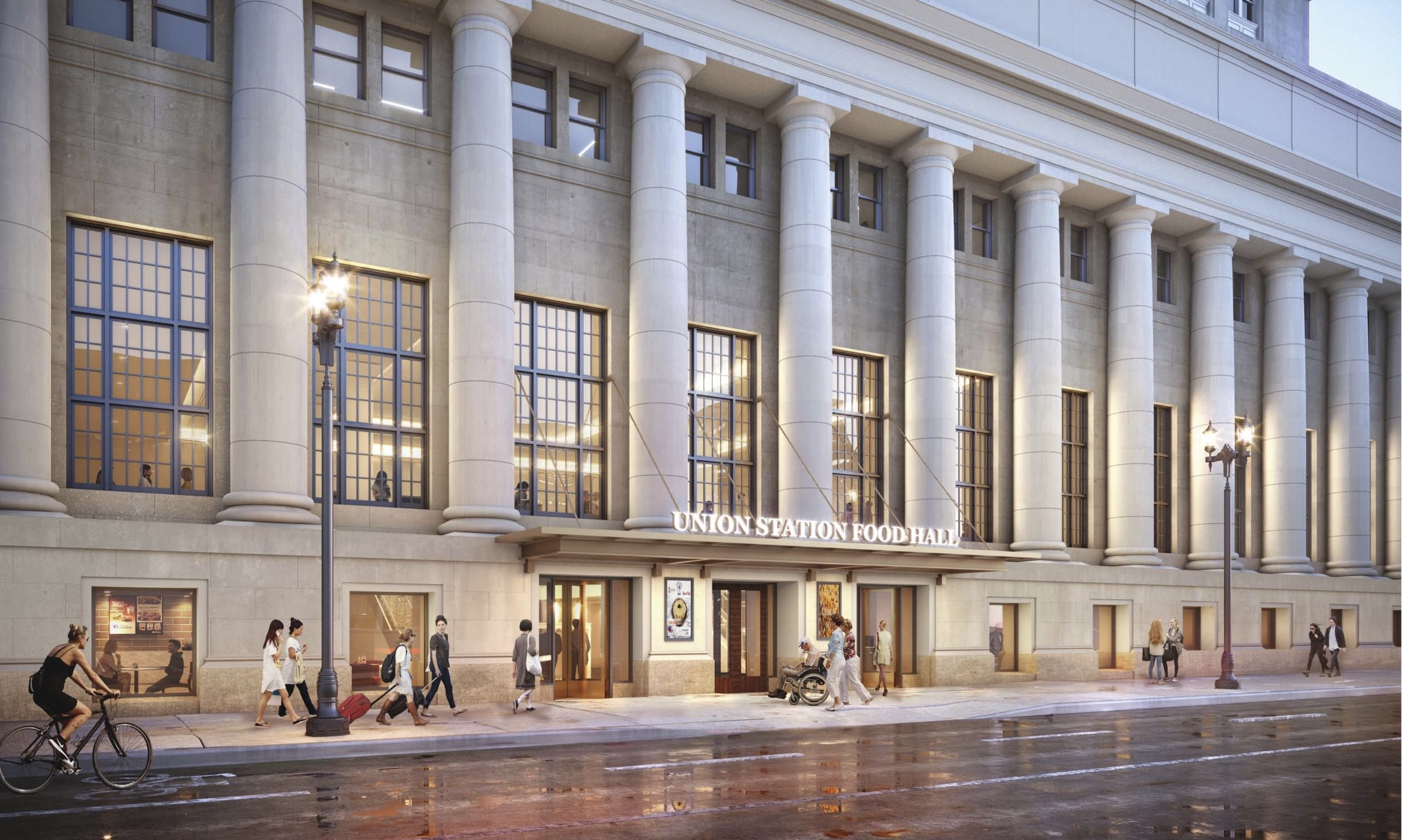 """A street-level view of Union Station's western wall, lined with round columns with windows in between. A new entrance canopy reads """"Union Station Food Hall."""""""