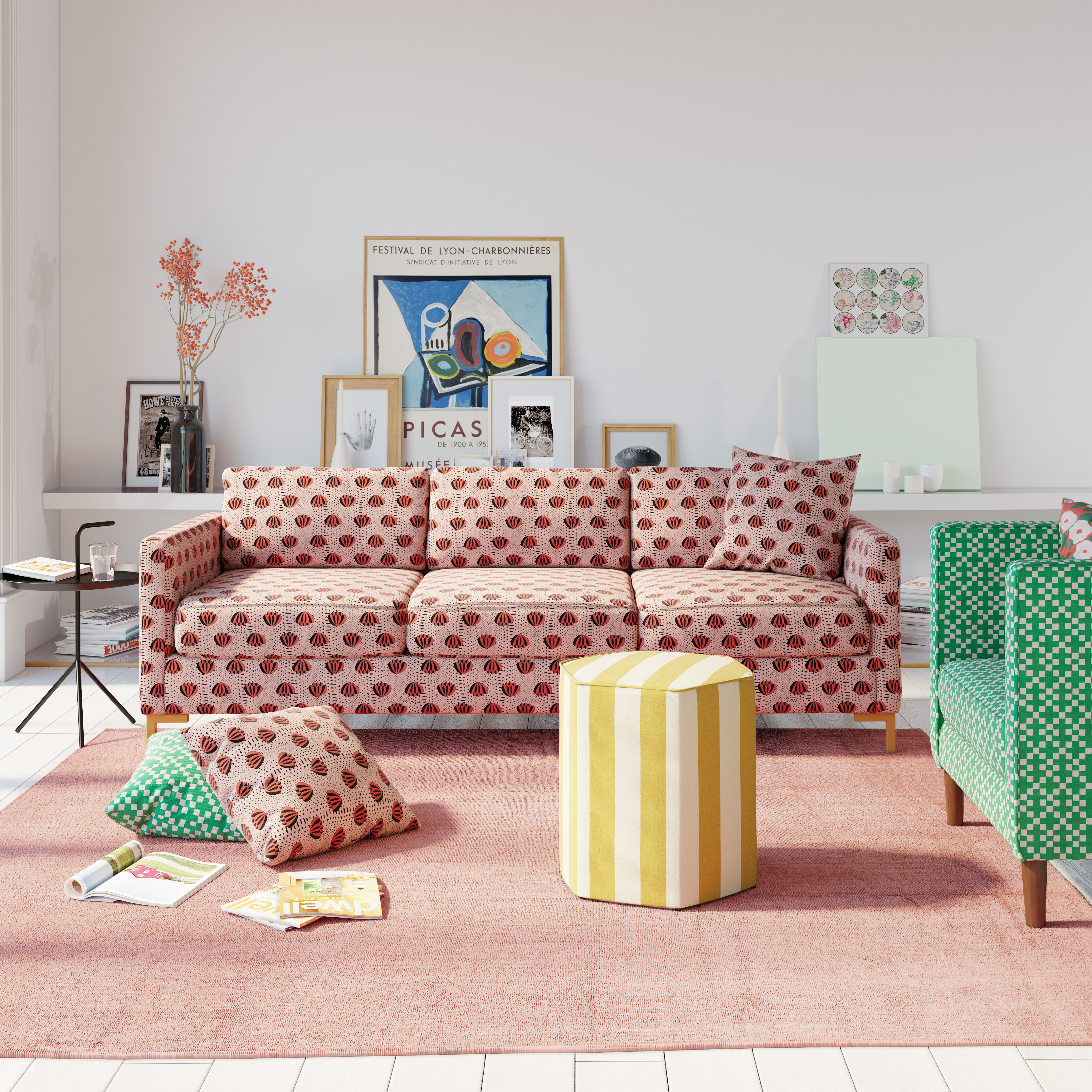 Pink floral-patterned sofa in a living room, next to matching pillow, and yellow-and-white striped ottoman.