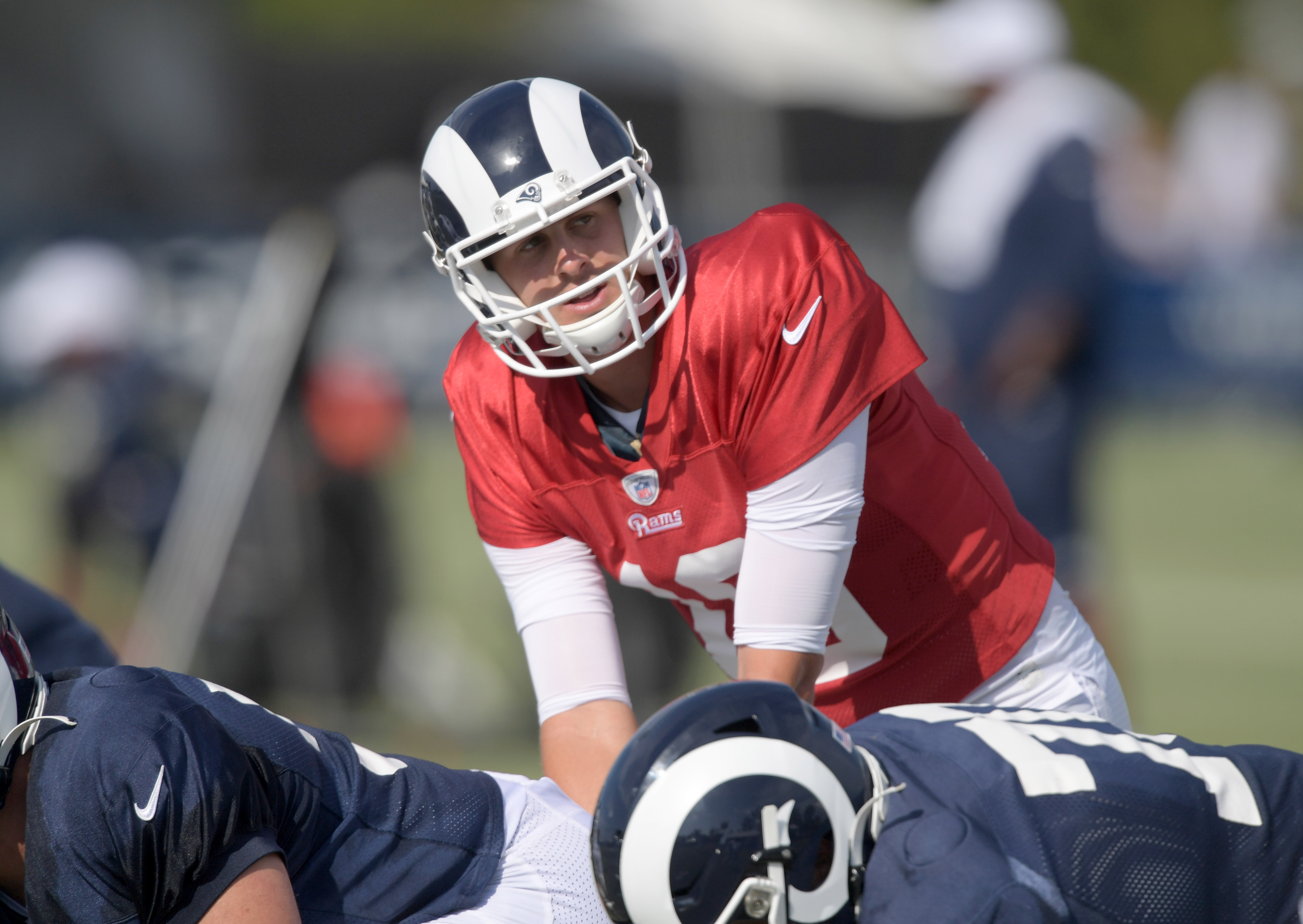 Los Angeles Rams QB Jared Goff takes a snap during training camp at UC Irvine, Jul. 30, 2019.