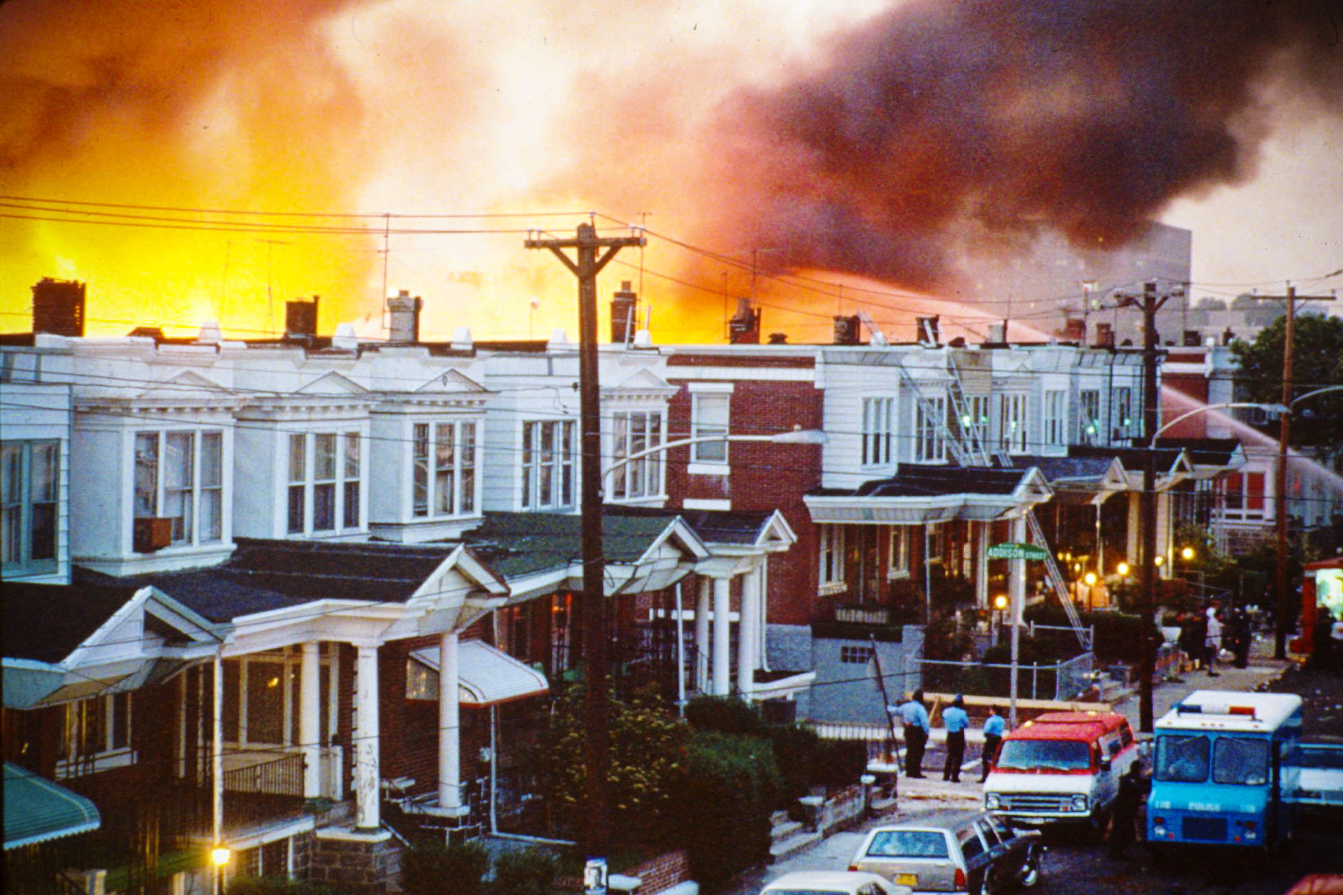 Row houses burn after local officials dropped a bomb on the MOVE house, home of a black liberation group, in Philadelphia, Pennsylvania, on May 13, 1985.