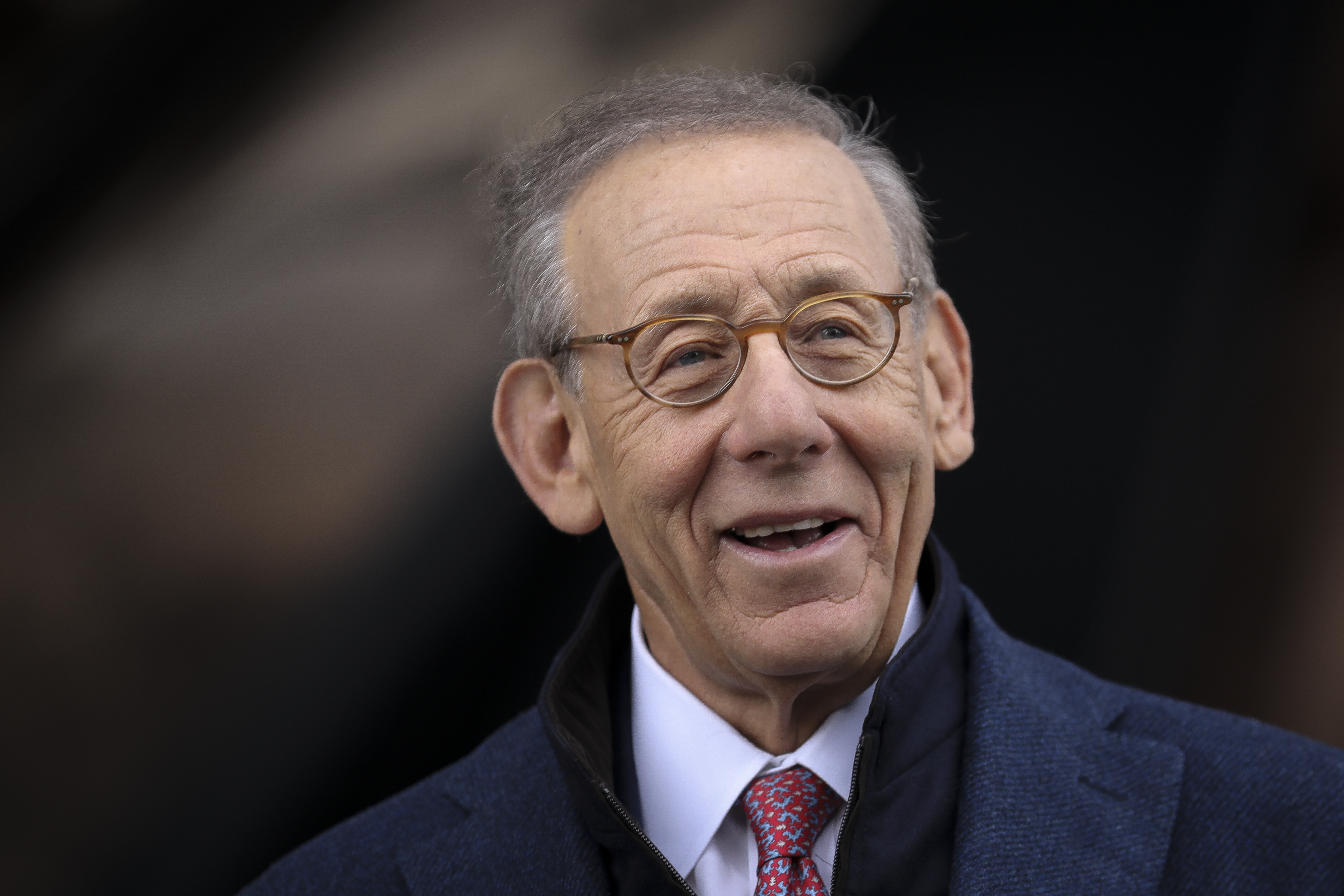 Stephen Ross against a blurred background