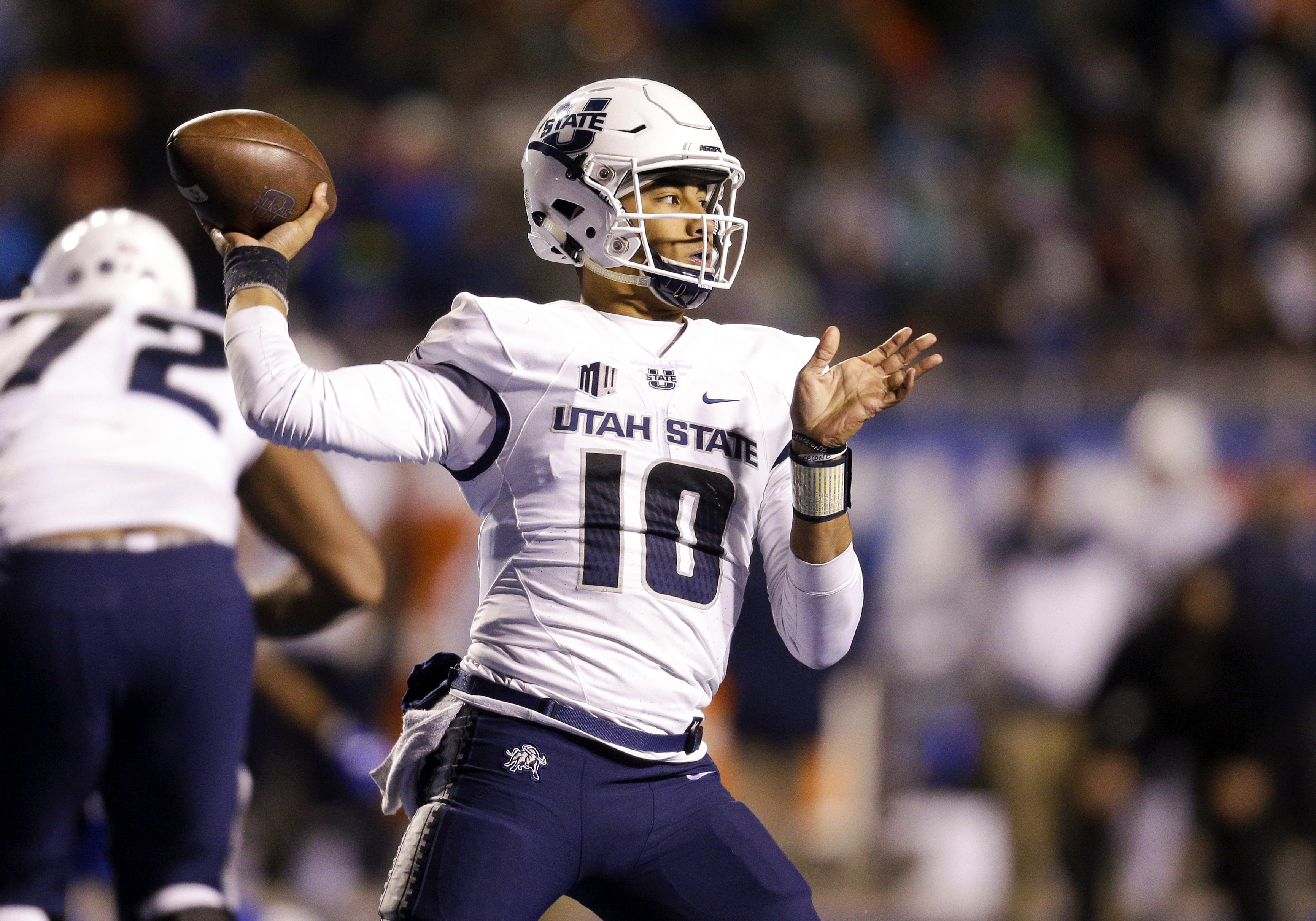 FILE - In this Saturday, Nov. 24, 2018 file photo, Utah State quarterback Jordan Love (10) looks to throw the ball against Boise State in the second of an NCAA college football game, Saturday, Nov. 24, 2018, in Boise, Idaho. The high-flying offenses of Ut