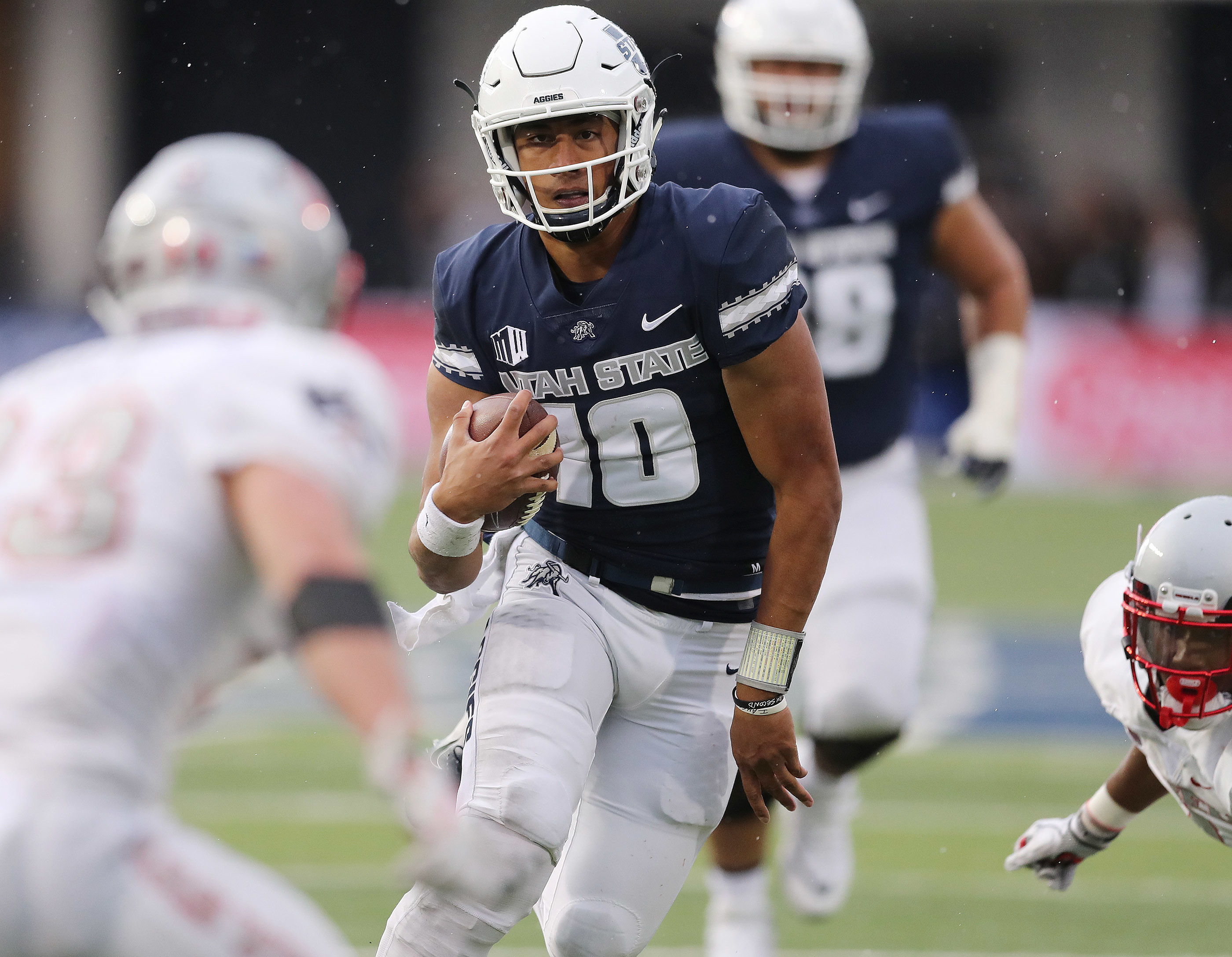 Utah State Aggies quarterback Jordan Love runs against UNLV in Logan on Saturday, Oct. 13, 2018.