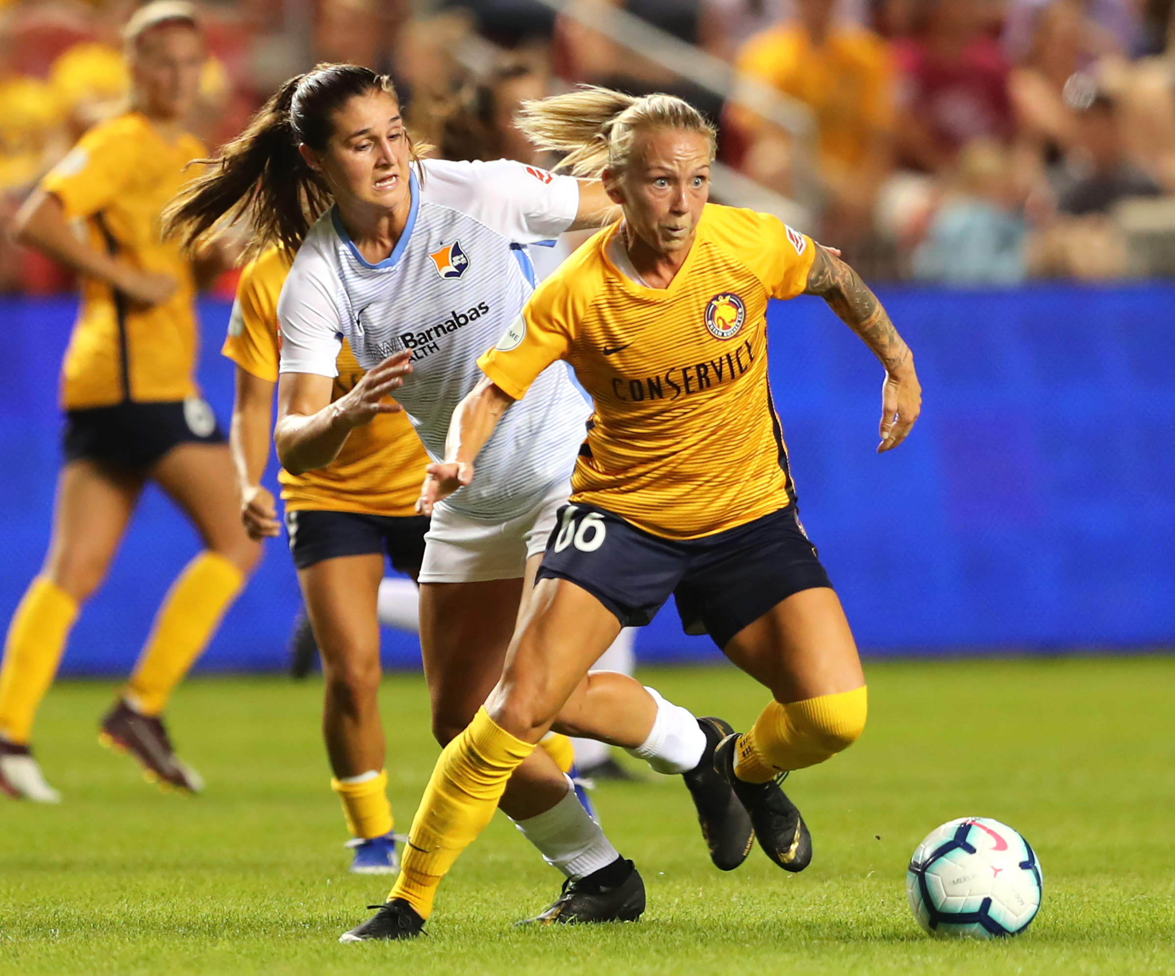 Utah Royals FC midfielder Gunnhildur Jónsdóttir (66) gets away from Sky Blue FC midfielder Julie James (5) as the Salt Lake Royals and Sky Blue FC play at Rio Tinto Stadium in Sandy on Wednesday, Aug. 7, 2019. The Royals won 3-0.
