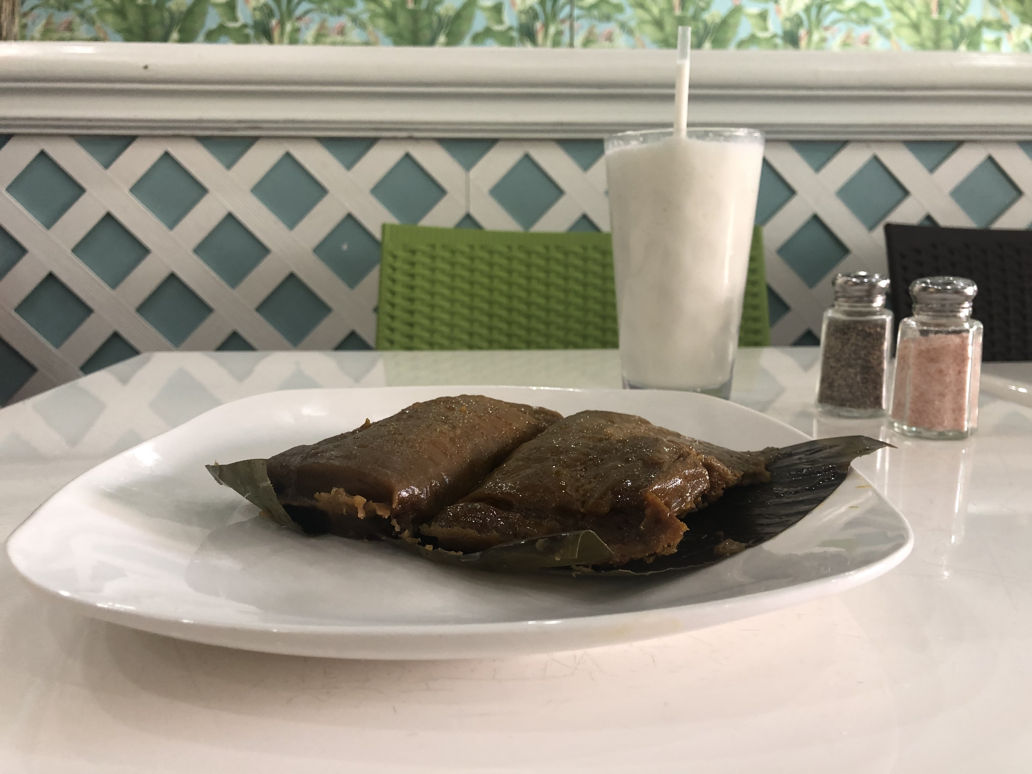 Pork pasteles at the Freakin Rican sit on a banana leaf