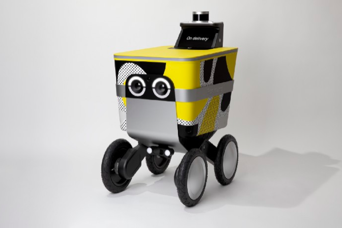 A boxy yellow delivery robot with circular eyes on the front.