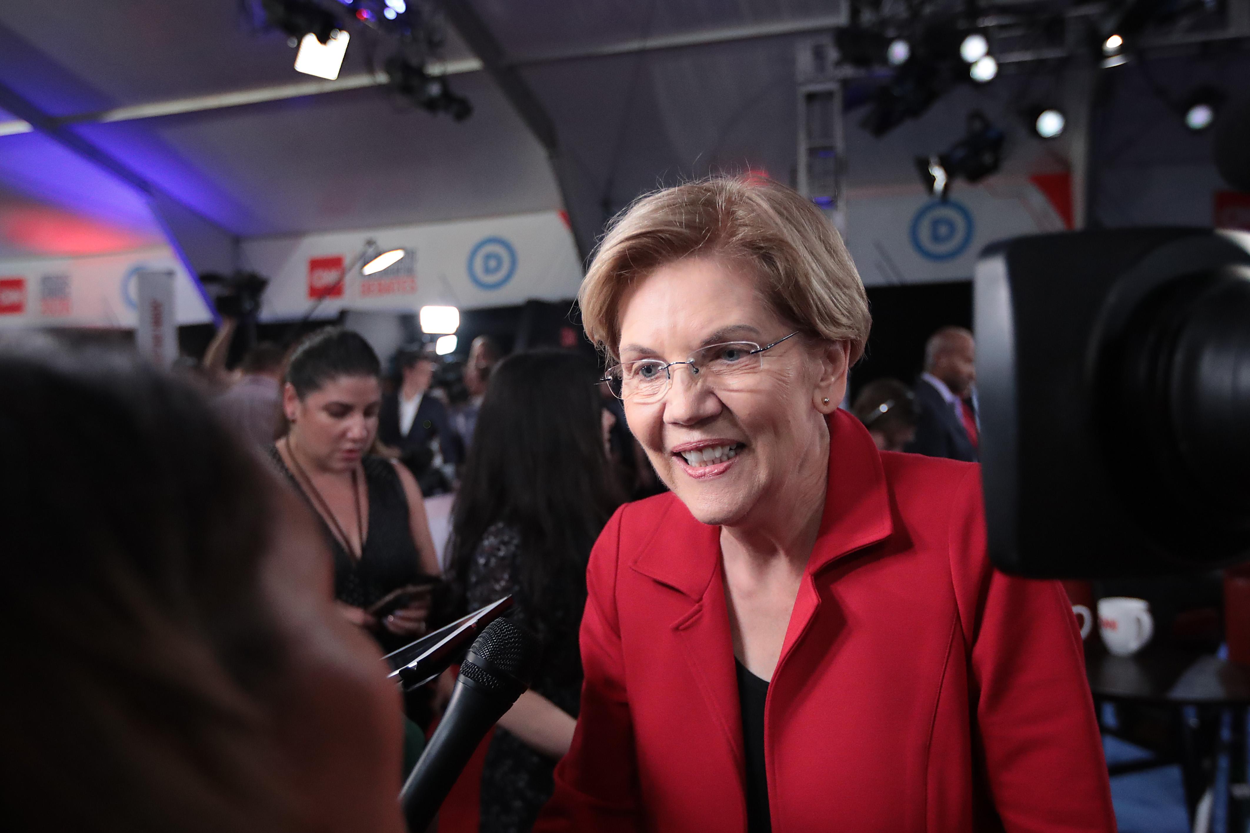 Elizabeth Warren speaks to reporters after the July 30, 2019, Democratic debates.