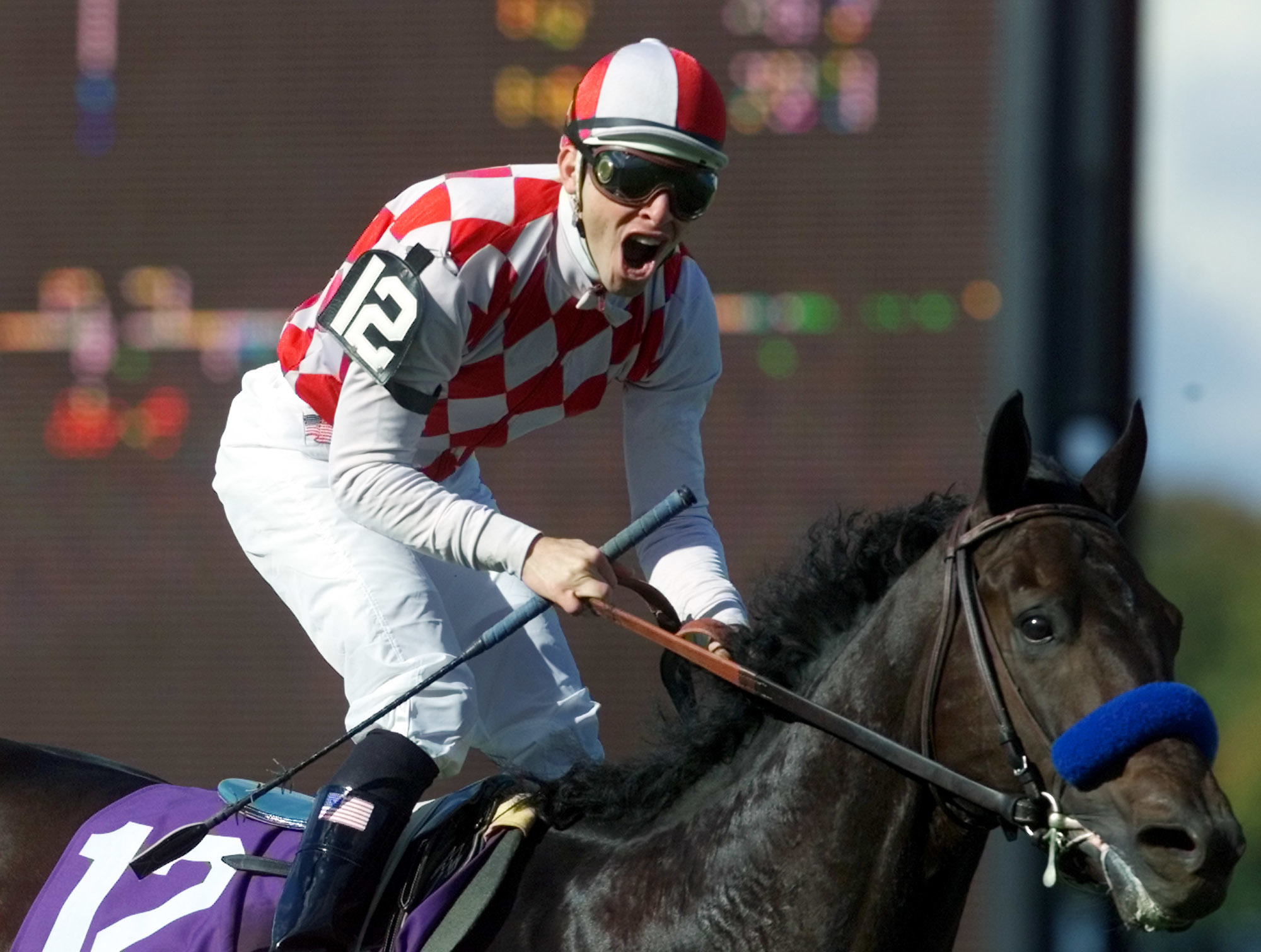 Jockey Jose Valdivia, Jr., reacts aboard Val Royal after winning the Breeders Cup Mile Race at Belmont Park Saturday, Oct. 27, 2001 in Elmont, N.Y.