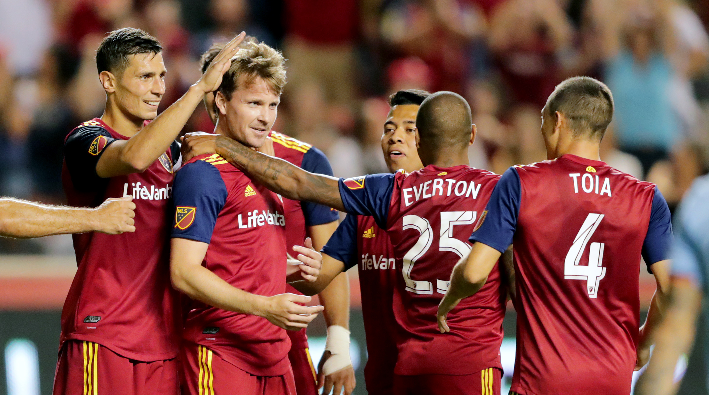 Real Salt Lake midfielder Nick Besler (13) celebrates a goal with teammates as Real Salt Lake and New York City FC play at Rio Tinto Stadium in Sandy on Saturday, Aug. 3, 2019. RSL won 3-1.