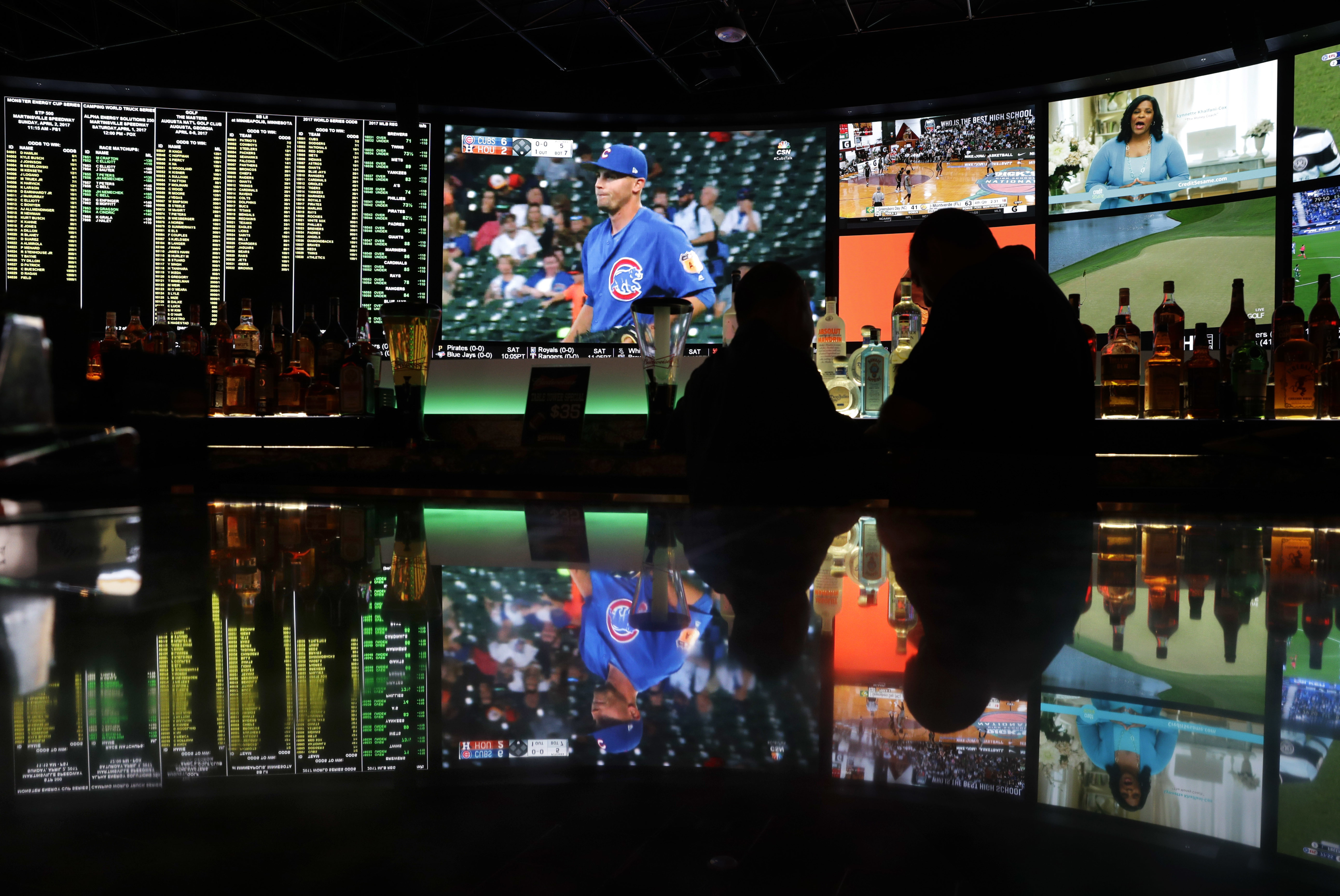 Bettors watch the Cubs and other teams play from the Westgate Superbook in Las Vegas in March 2017.