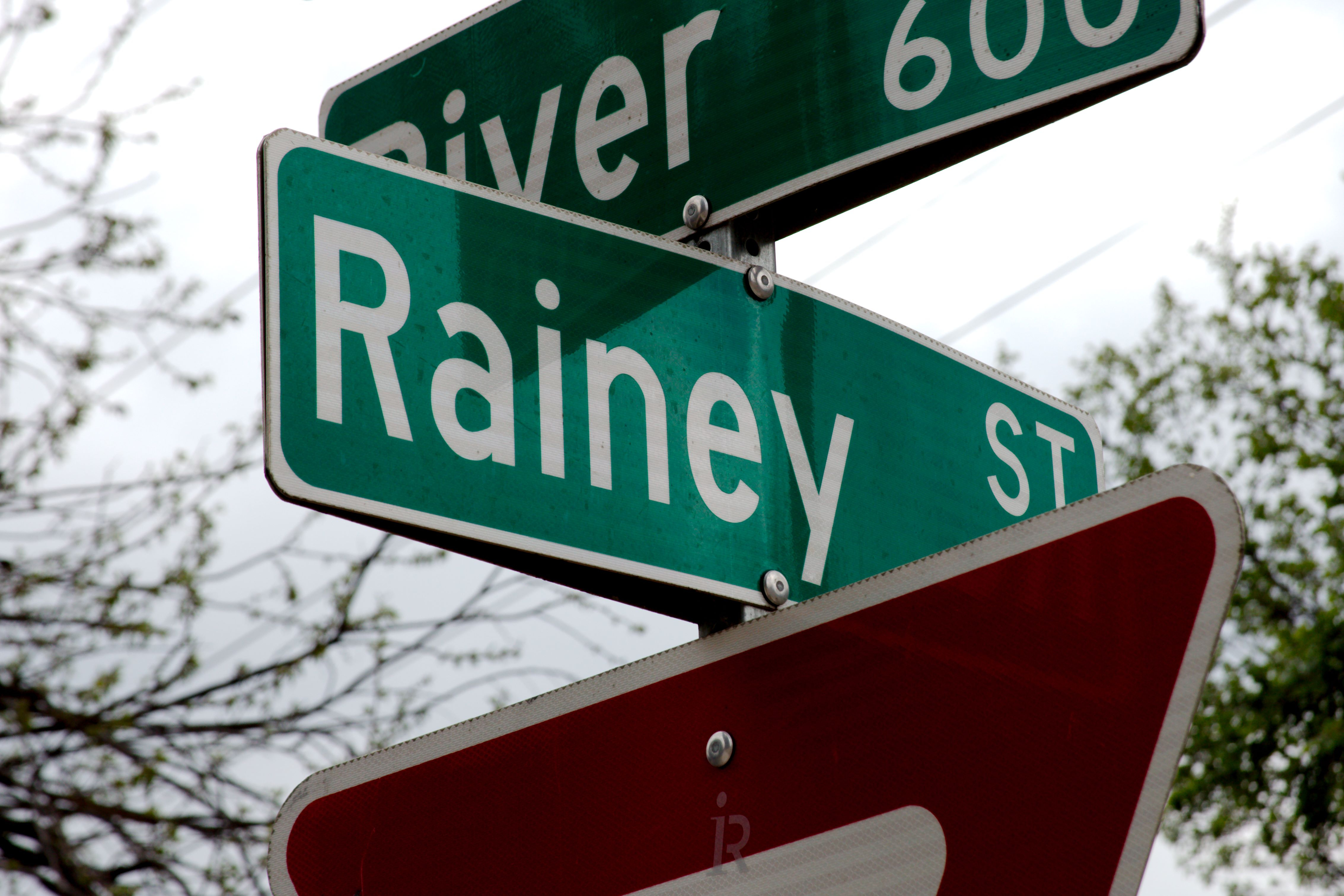Street signs for Rainey and Red River streets