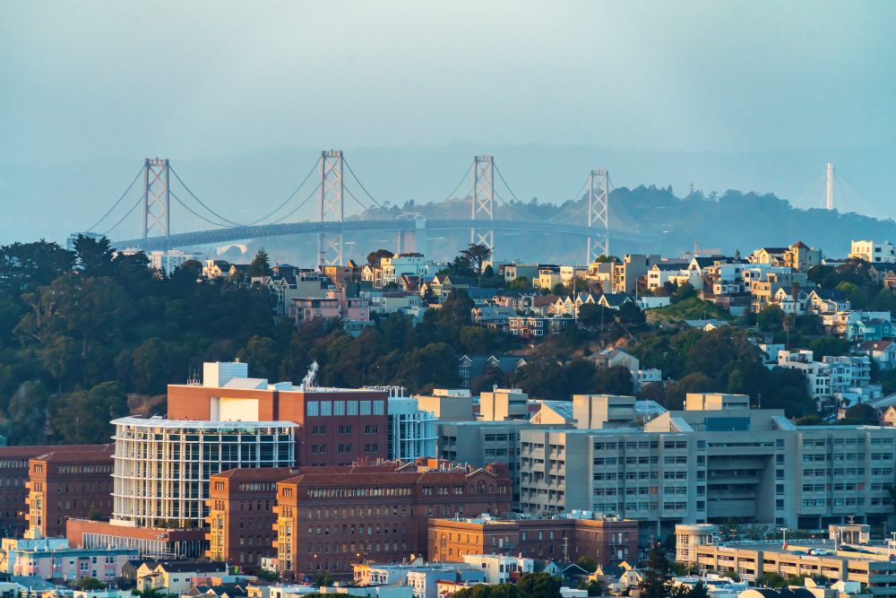 The Bay Bridge rising behind condo developments in San Francisco.