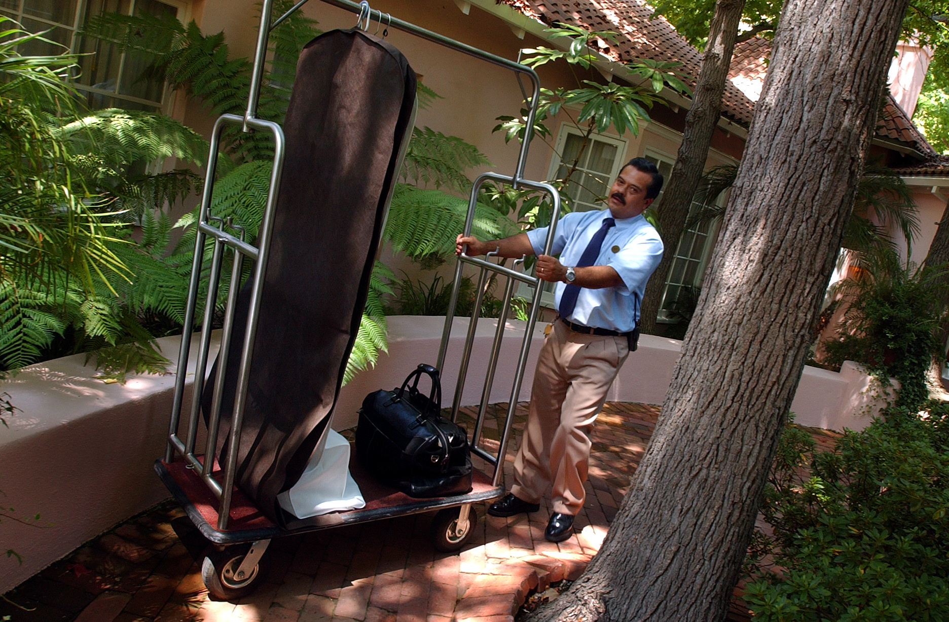 Tony Marquez is the only bellhop in the U.S. to get a 5–star rating from the Mobil hotel rating service. Here, he's seen in action at the Hotel Bel–Air in California on Aug. 13, 2004.