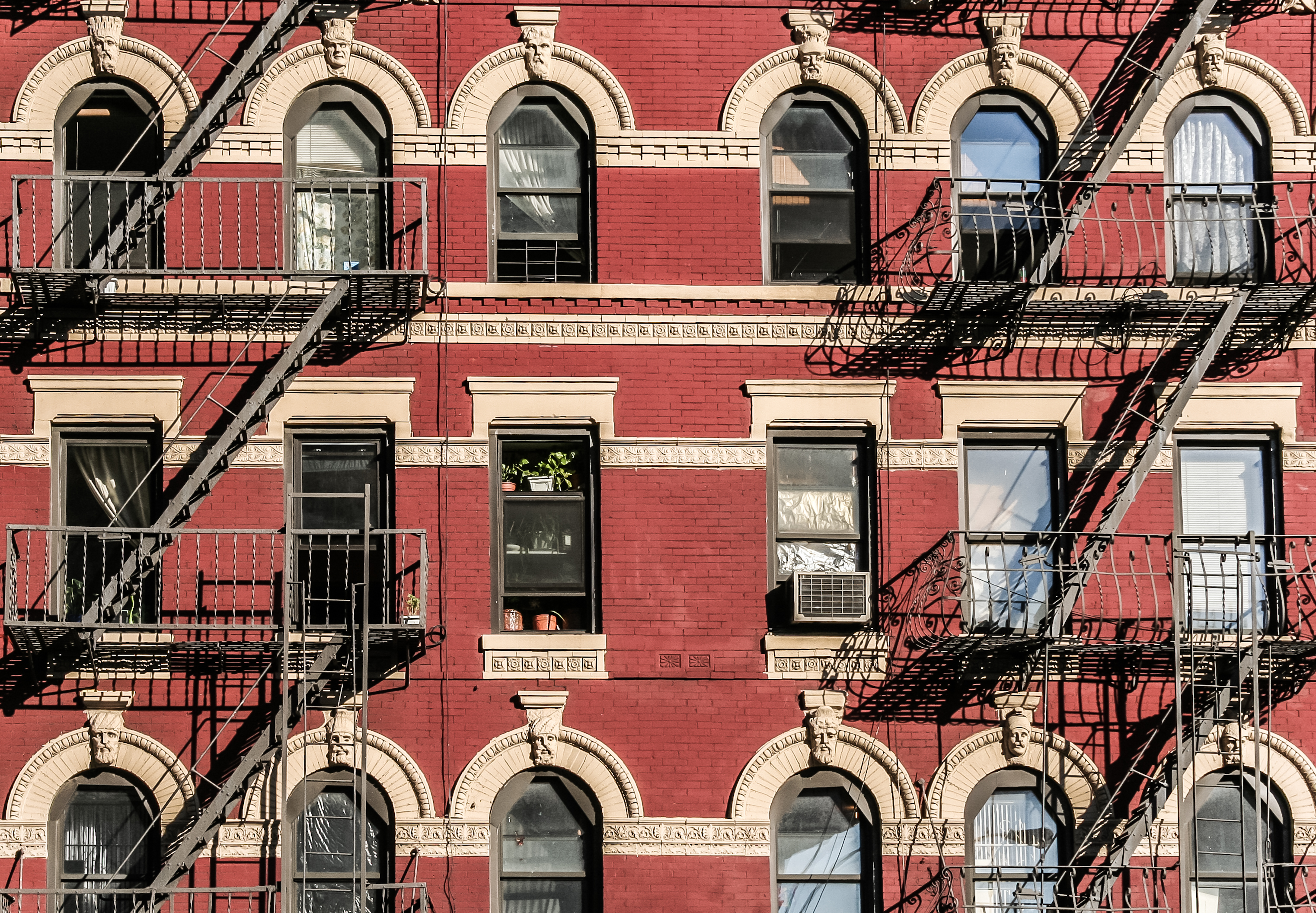 NYC building with several fire escapes.