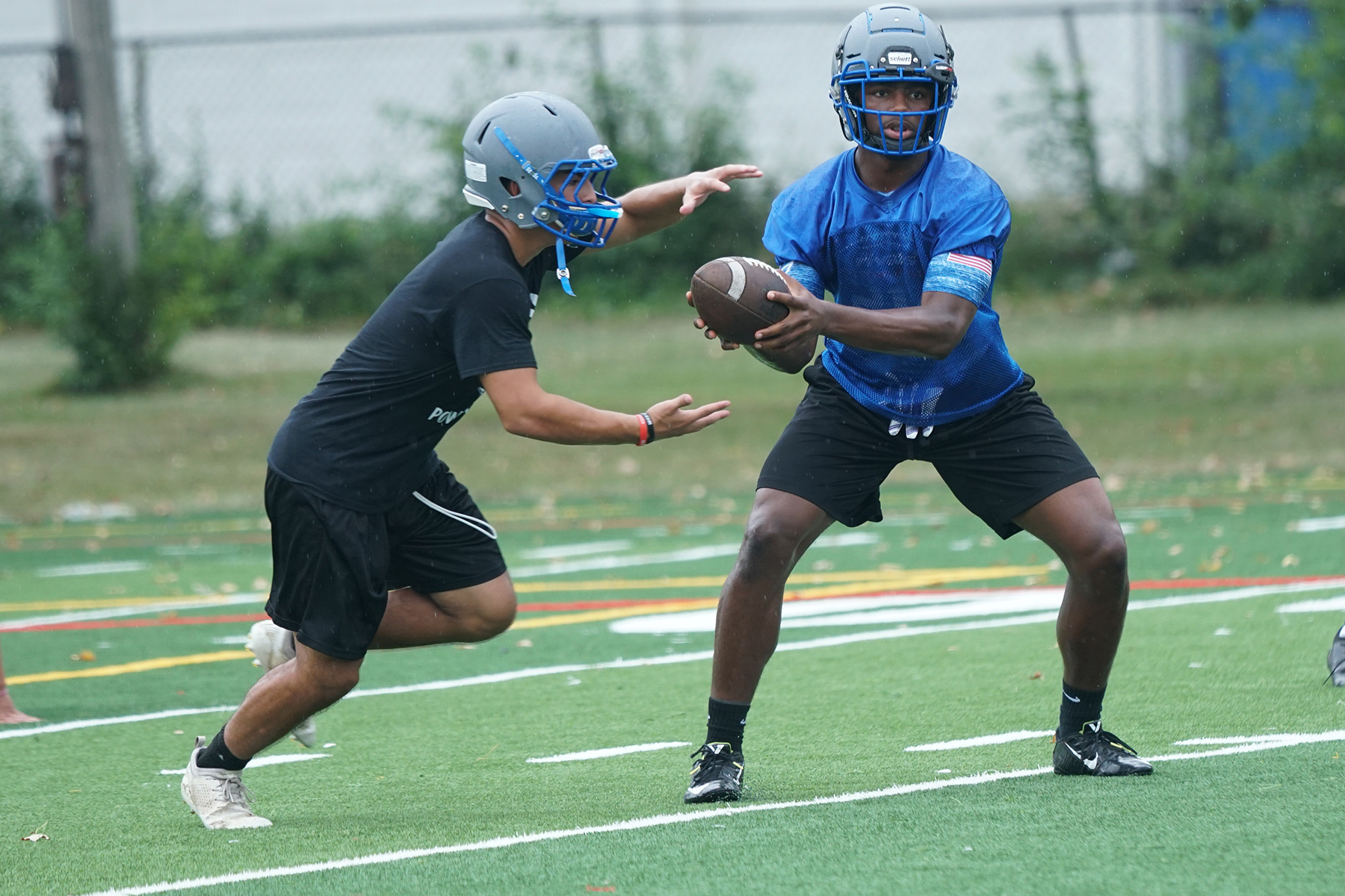 Taft's Dexter Stigall IV hands the ball off during the first practice of the season.