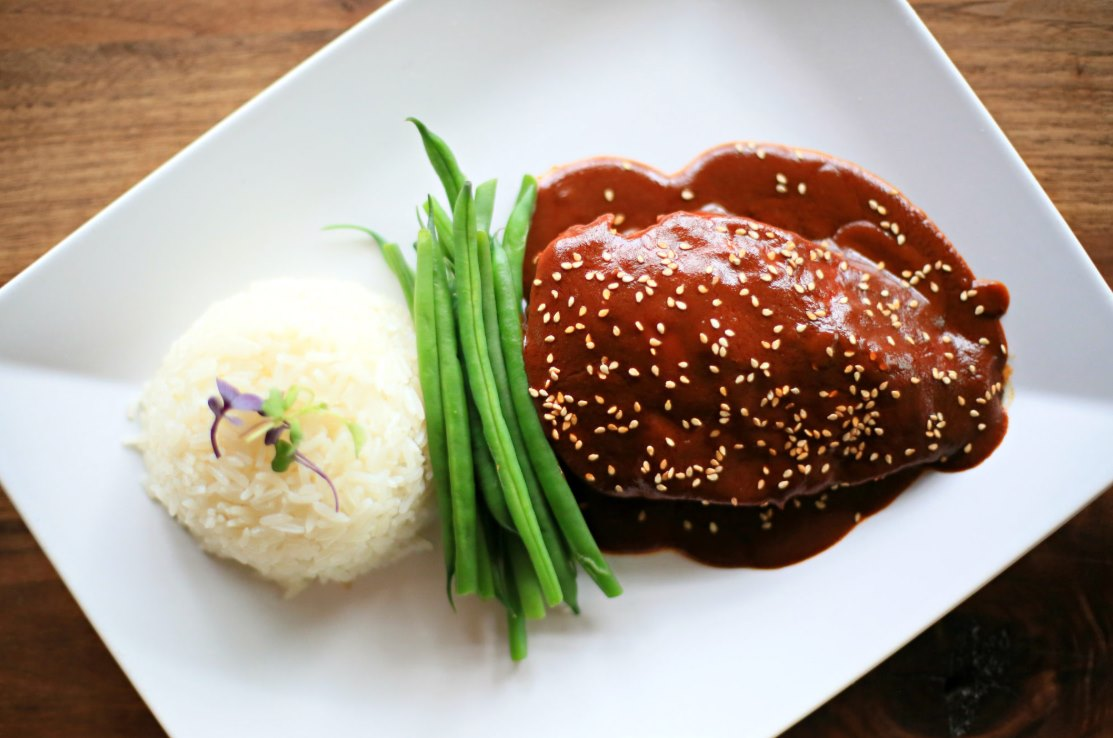 chicken in mole sauce with rice and green beans
