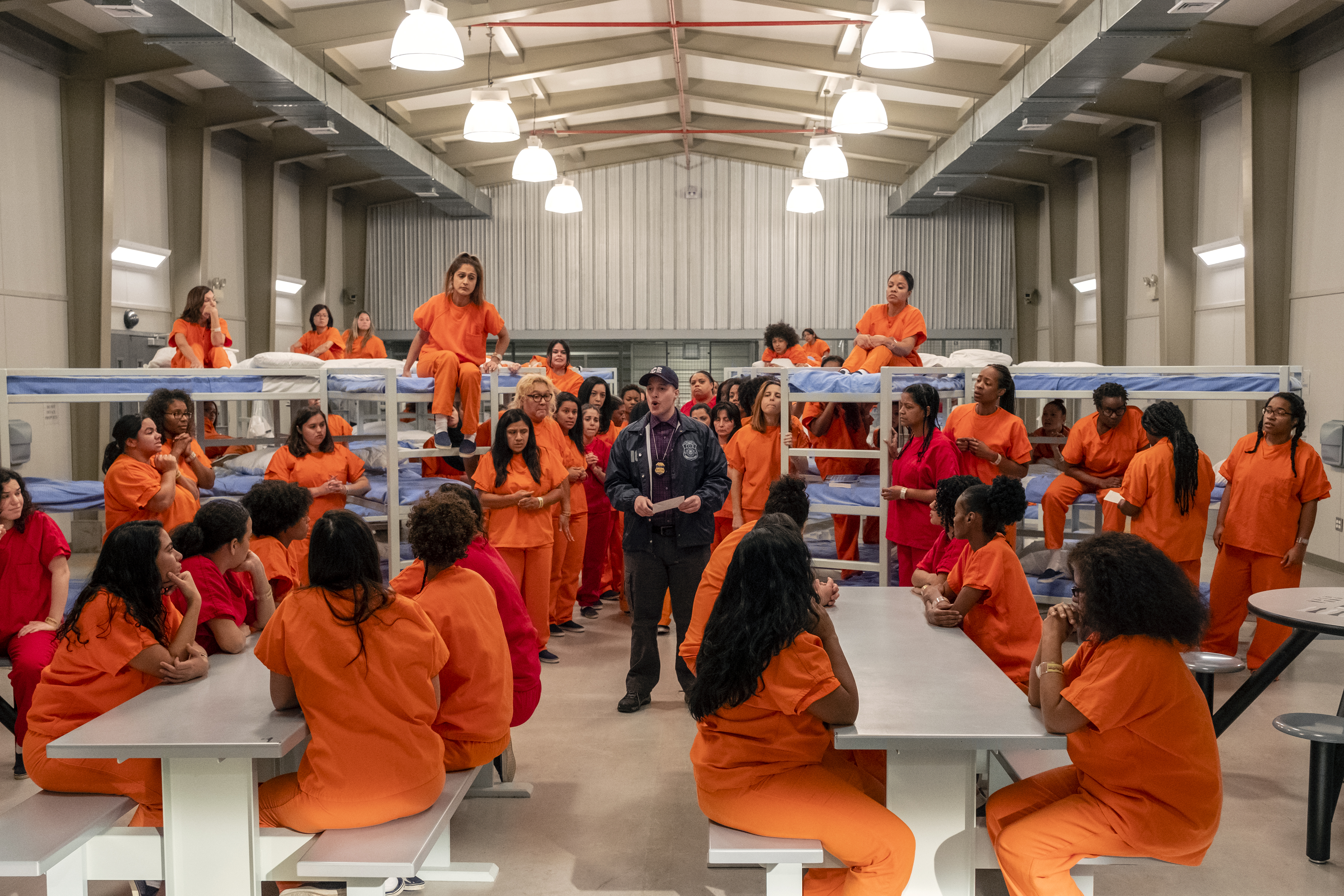 Inmates and a guard inside an ICE detention facility recreated for Orange Is The New Black.