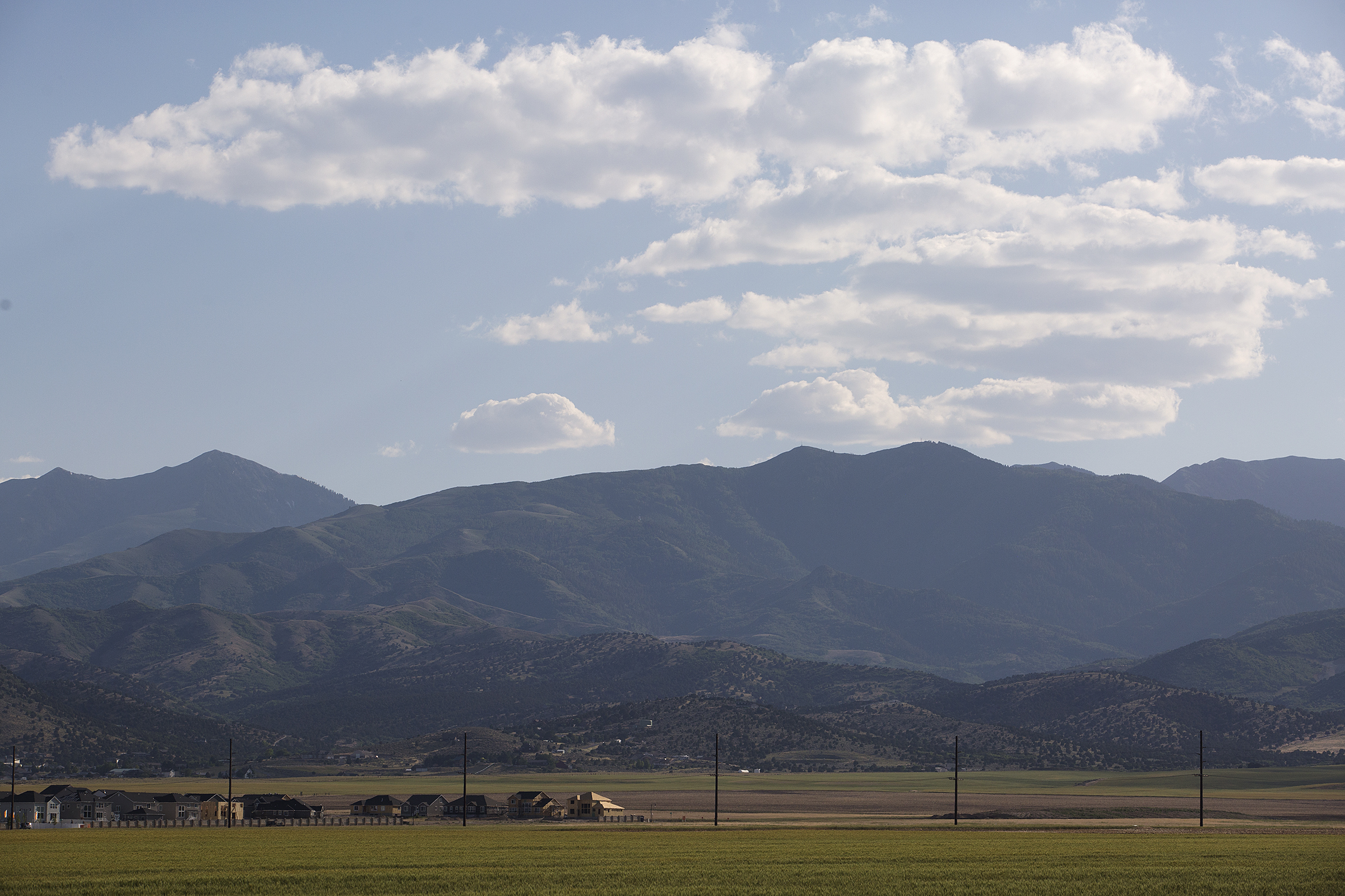 The Olympia Hills development was proposed just west of Herriman, beyond the telephone poles in this photo taken from Herriman High School on Thursday, June 14, 2018.