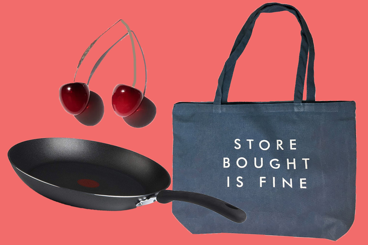 "Cherry earrings, ""Store Bought Is Fine"" tote bag, and a nonstick frying pan on a pink background"