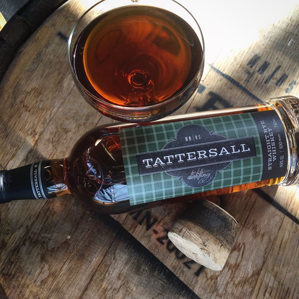 A bottle of Tattersall rye beside a full glass