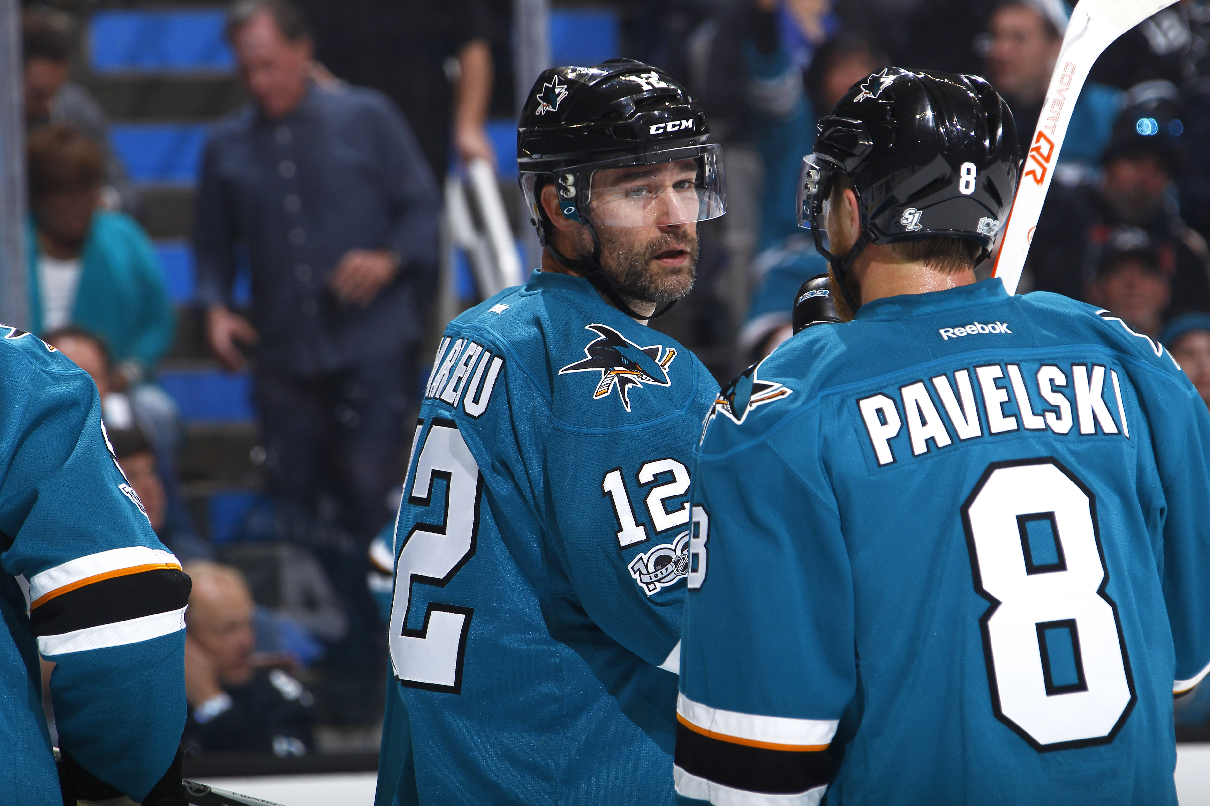 Patrick Marleau and Joe Pavelski of the San Jose Sharks talk during Game 6 of the Western Conference First Round during the 2017 NHL Stanley Cup Playoffs at SAP Center on April 22, 2017 in San Jose, California.