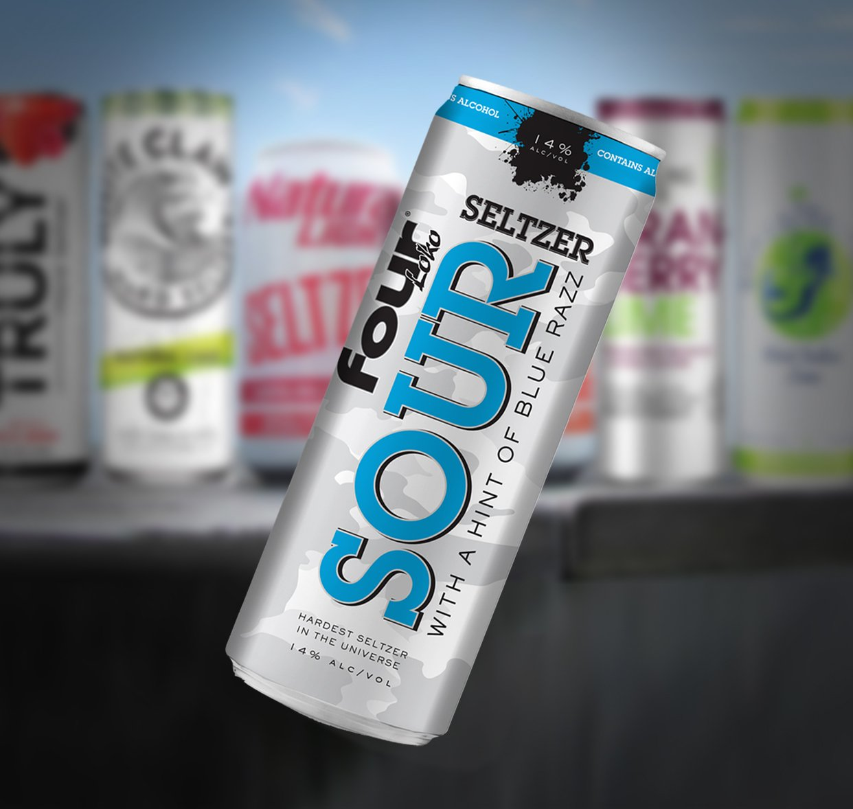 A blue and silver can reading 'Four Loko Seltzer Sour' tilted sideways in front of a blurred background of other cans.