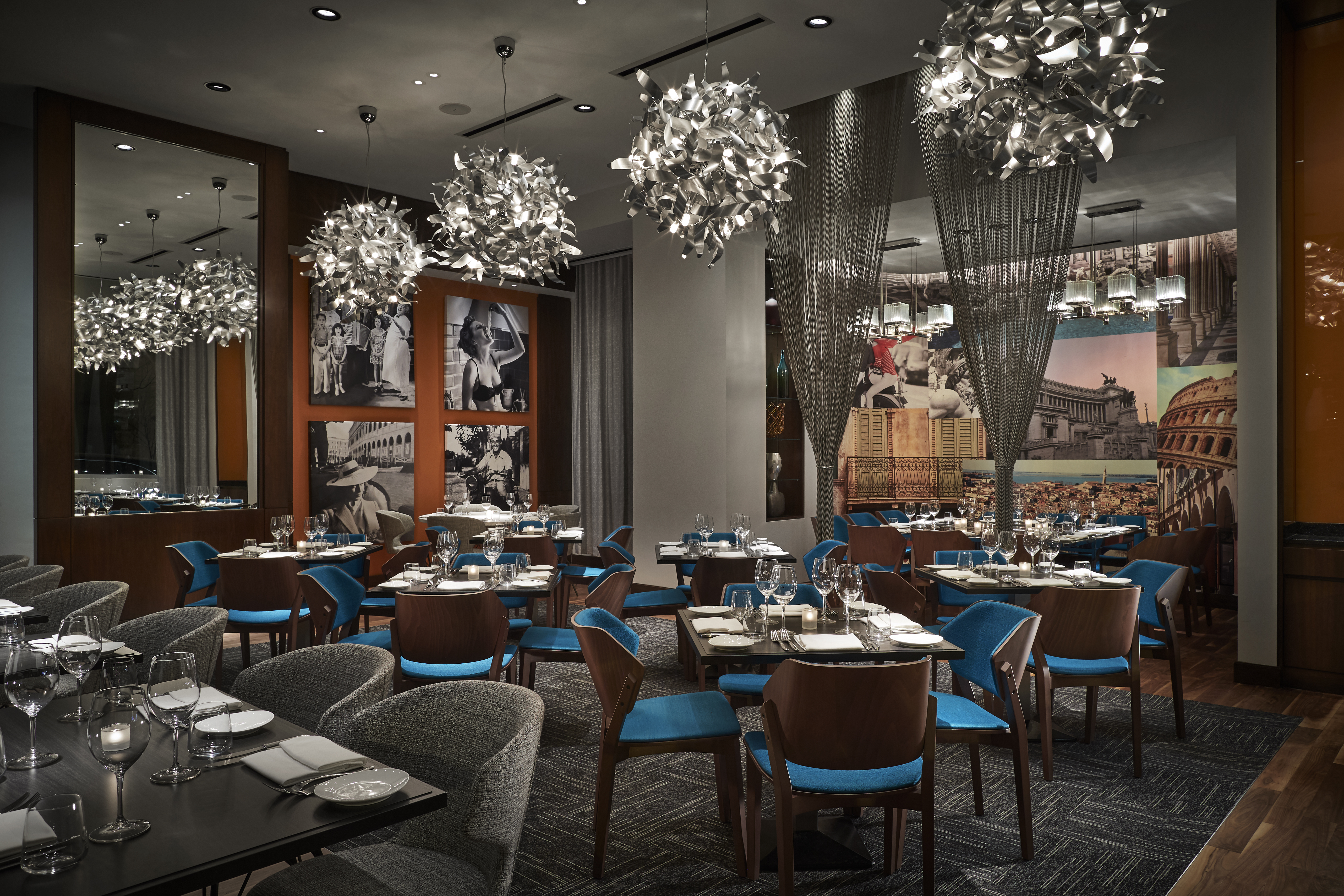 Tables, chairs, and art inside the dining room at Bibiana, which was renovated in January 2018.