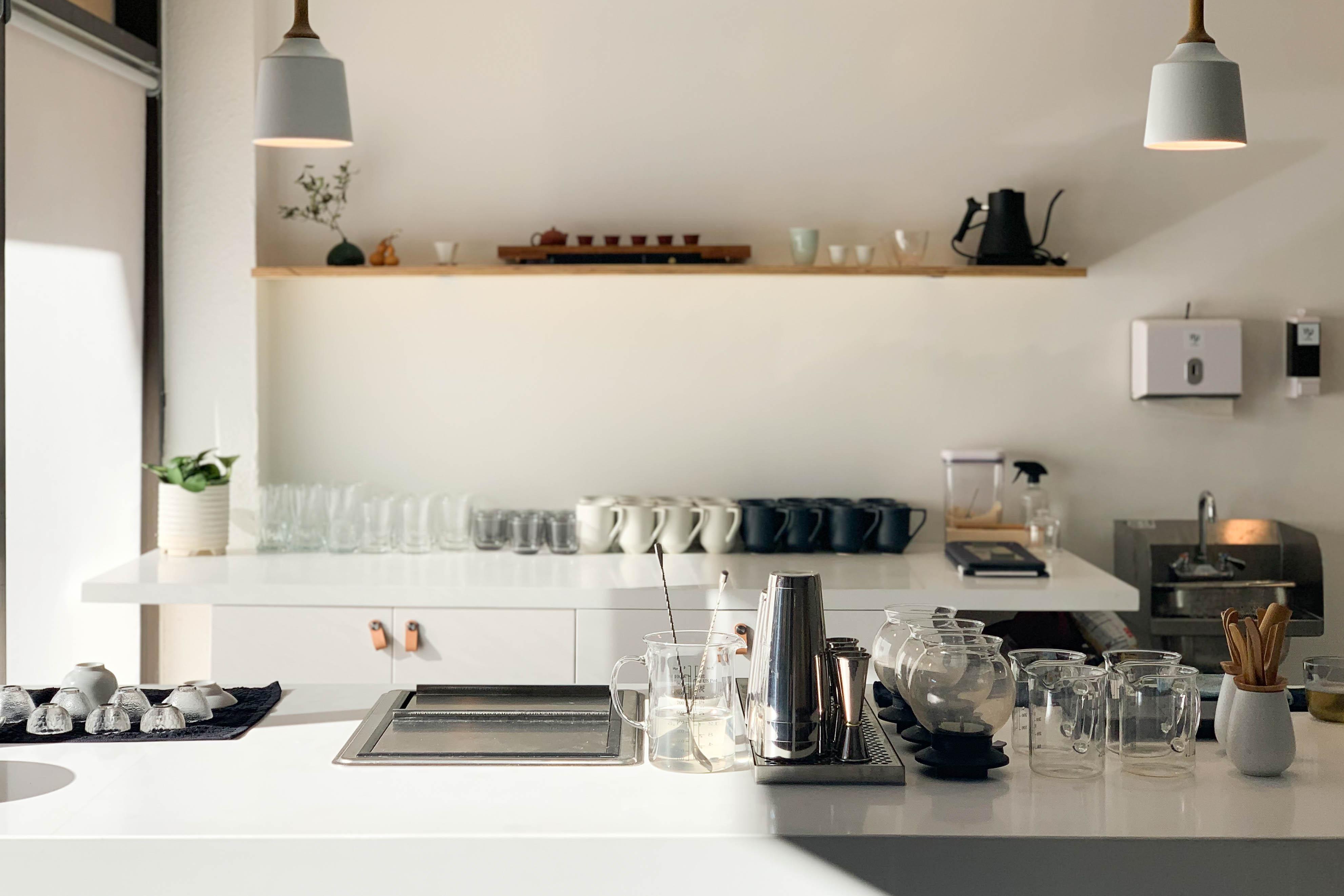 A sleek, modern tea bar, set up for service as the sun streams in.