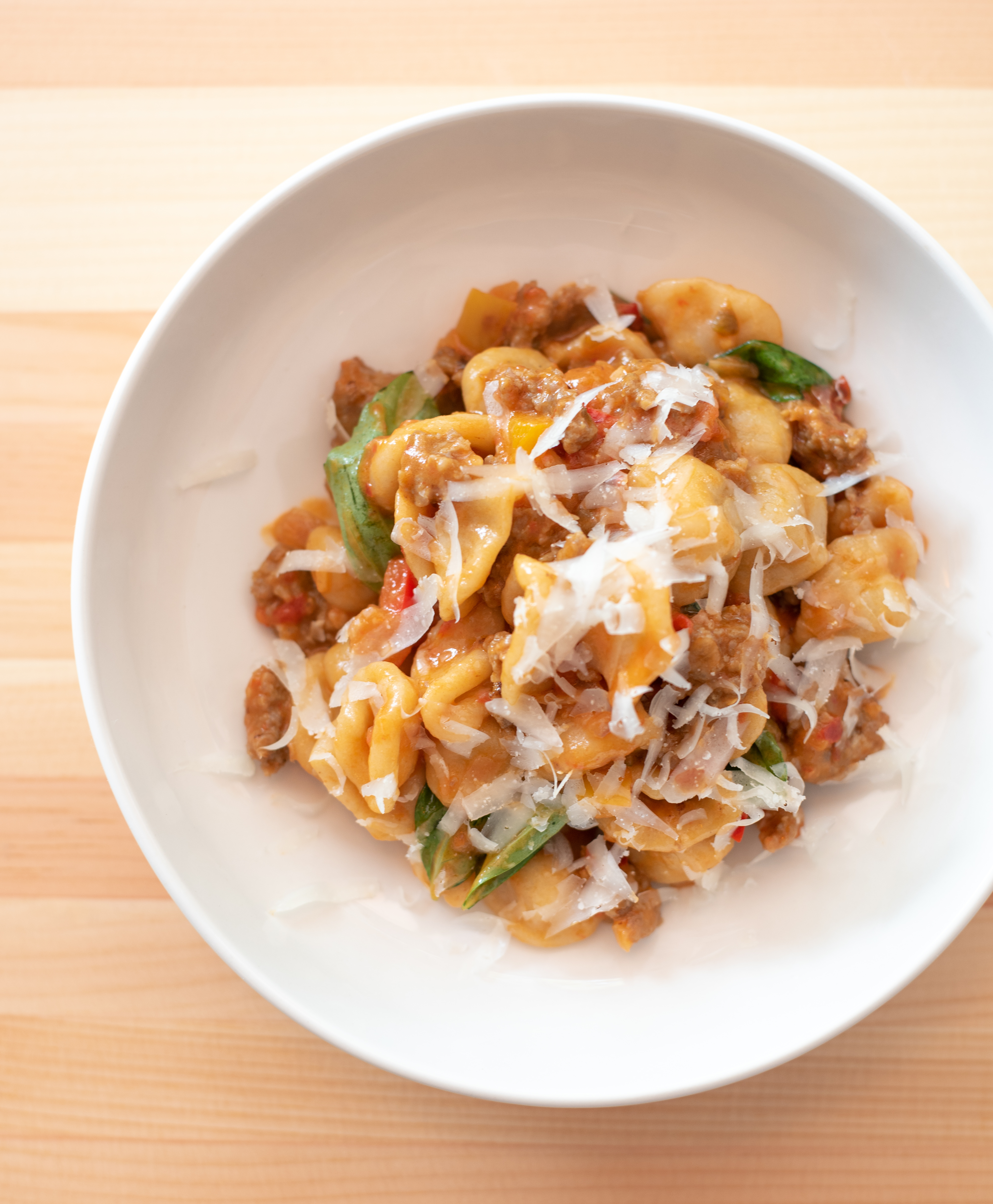 Orecchiette, packed with spicy sausage, pepperonata, and pecorino.