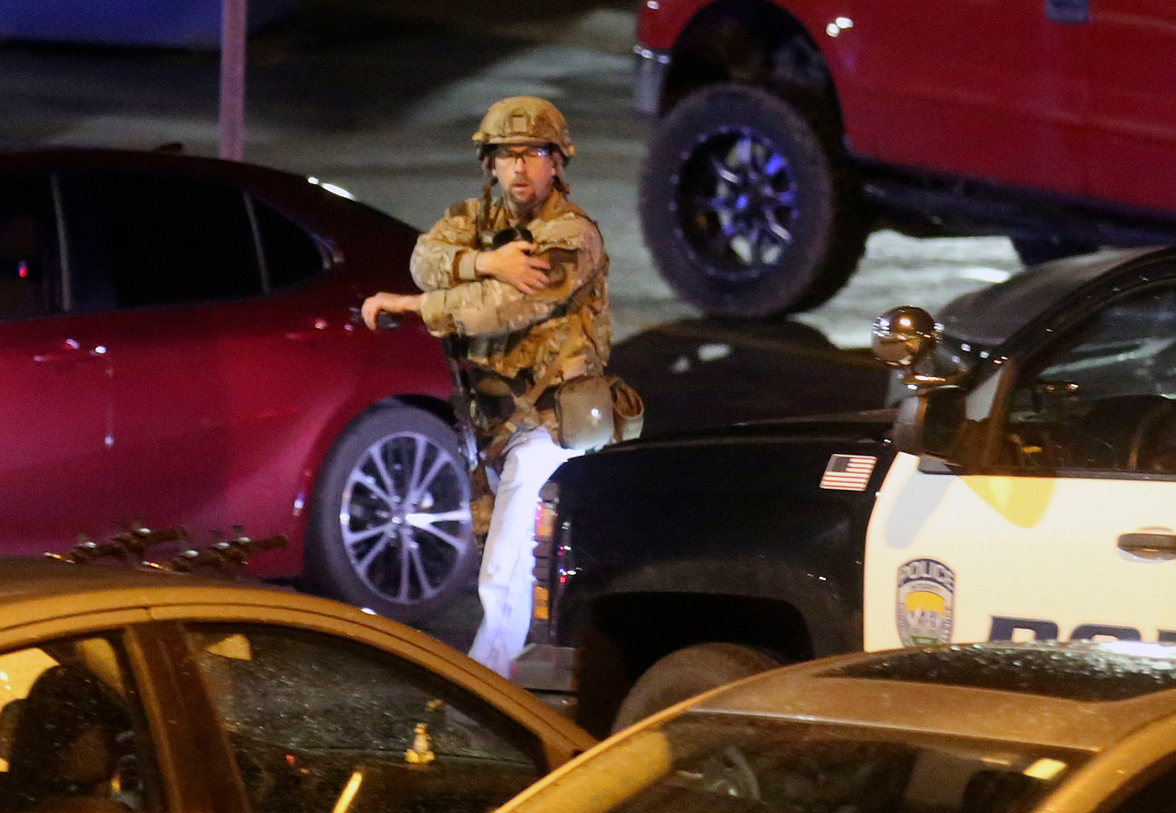 Police work near the South Medical Tower on the University of Utah campus in Salt Lake City as they search for a shooting suspect on Monday, Oct. 22, 2018.
