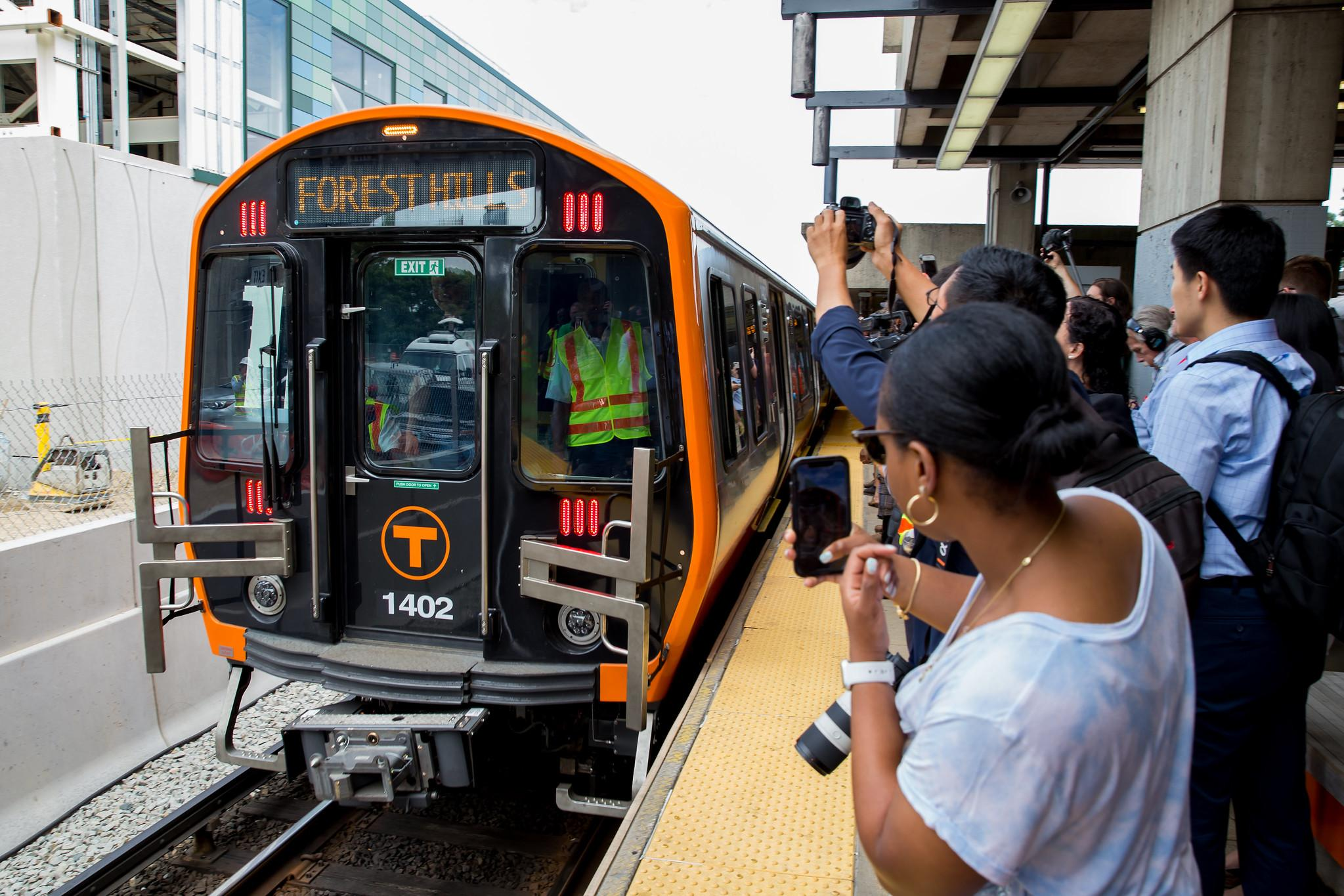 New Orange Line cars rolling out of Wellington Station.