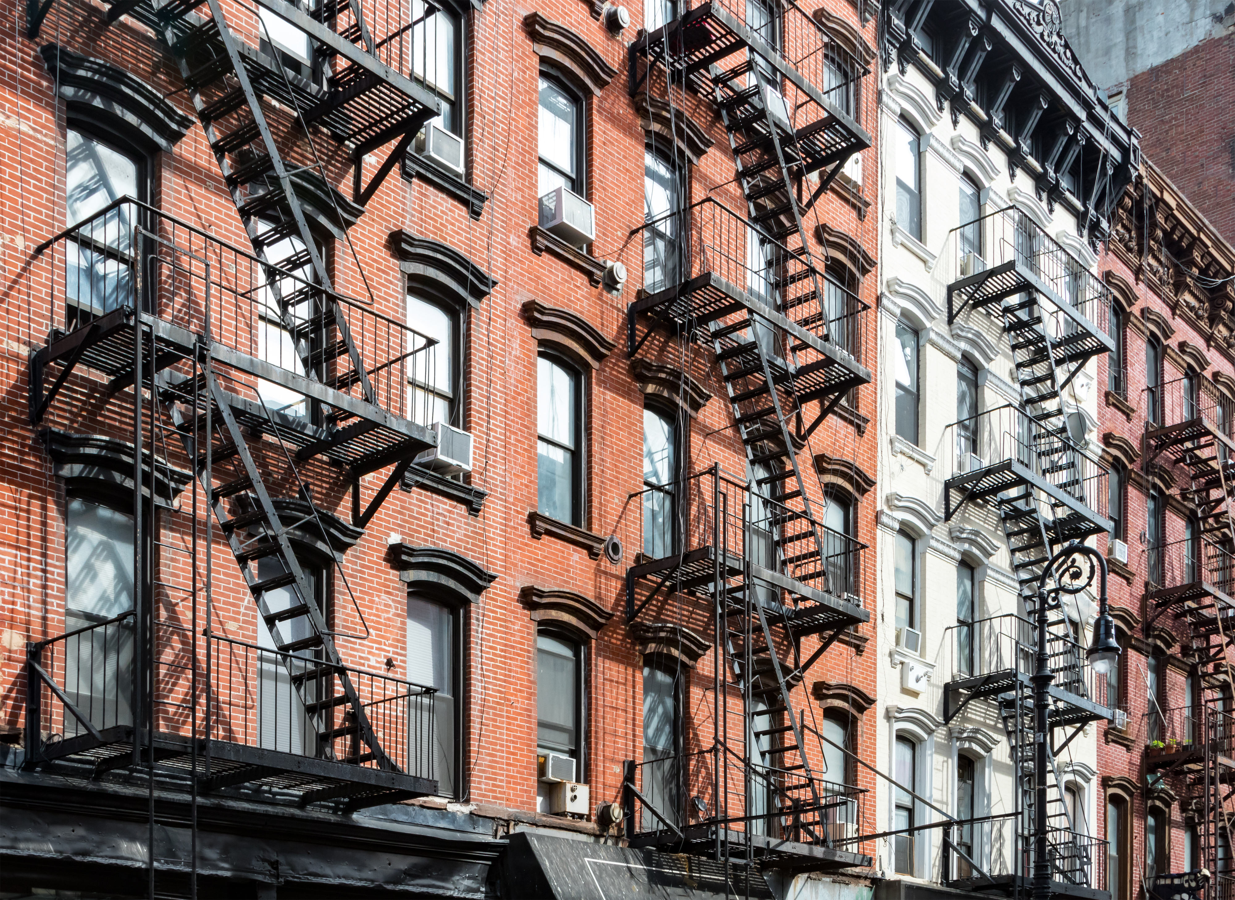 Buildings with fire escapes in NYC's Lower East Side.