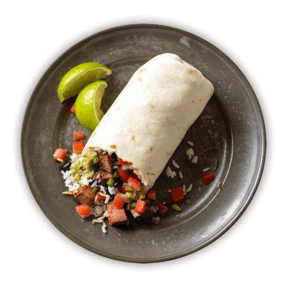 A burrito spills its contents onto a gray plate with slices of lime alongside
