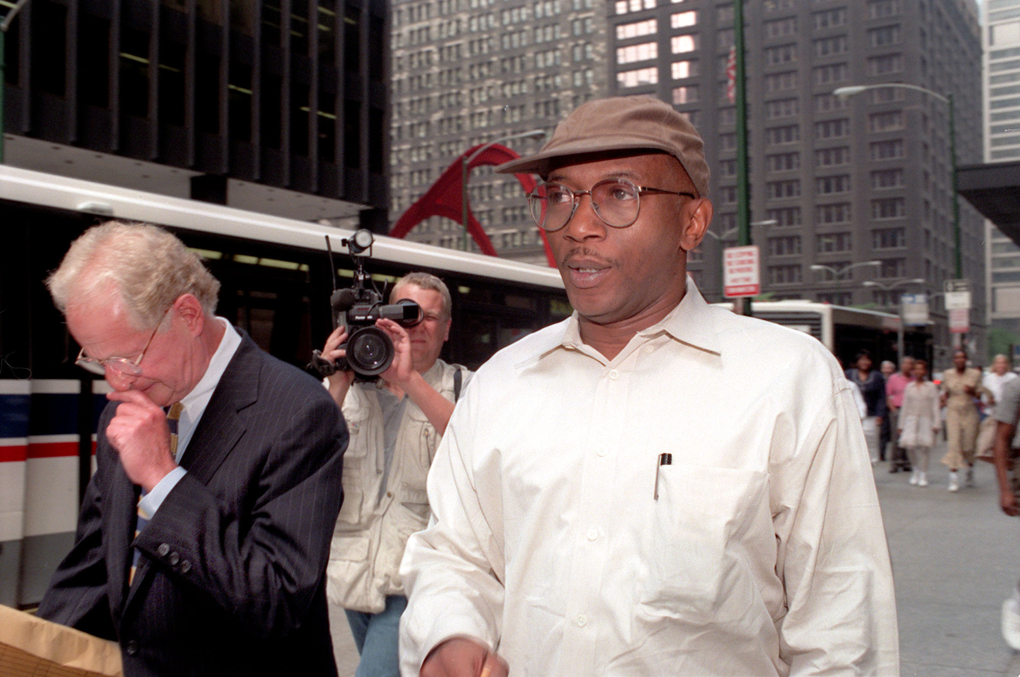 James Blassingame (in cap) leaves federal court in Chicago with his attorney Rick Halprin in July 1996 after being arraigned in Operation Silver Shovel.