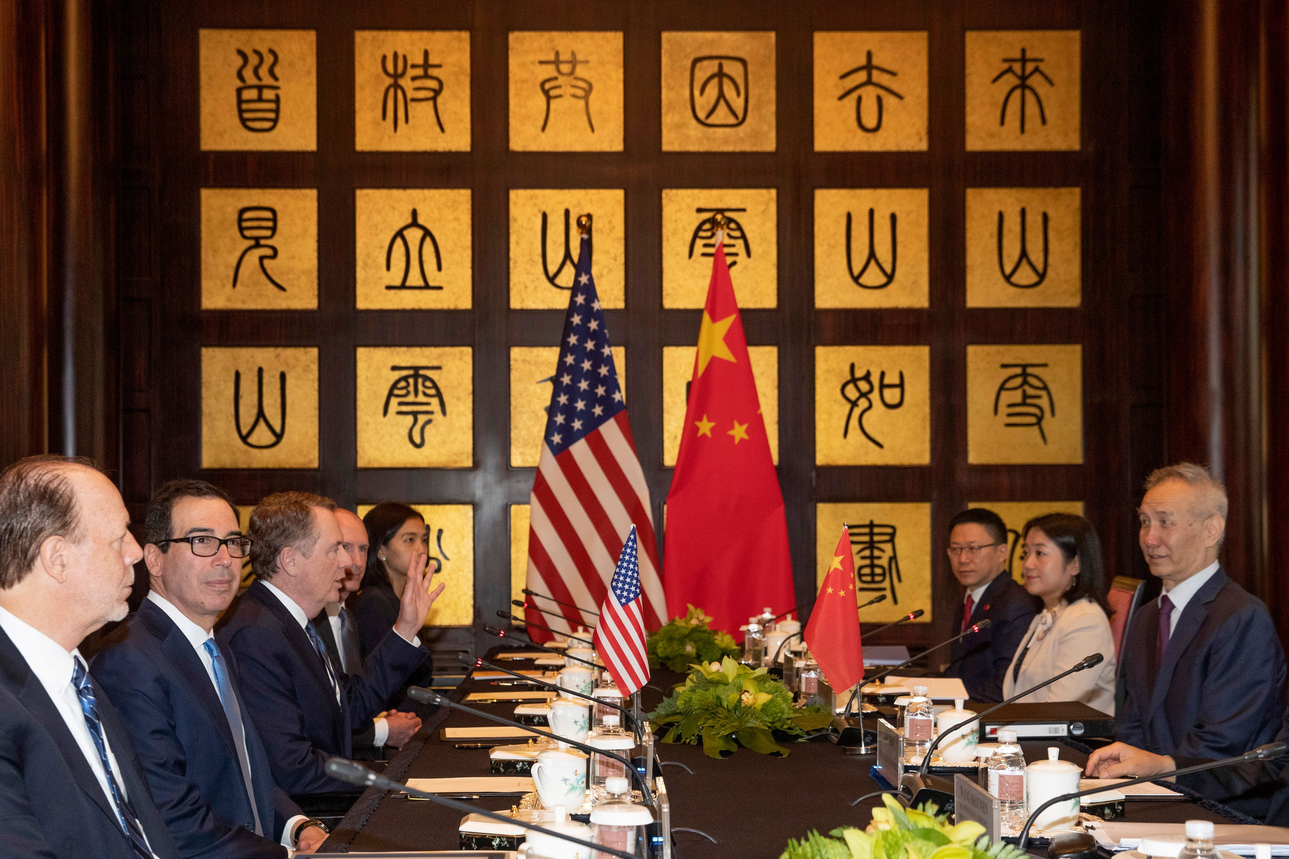 Chinese and American officials sit at a table.