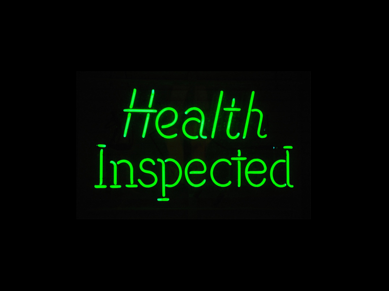 "Neon sign that says ""health inspected"""