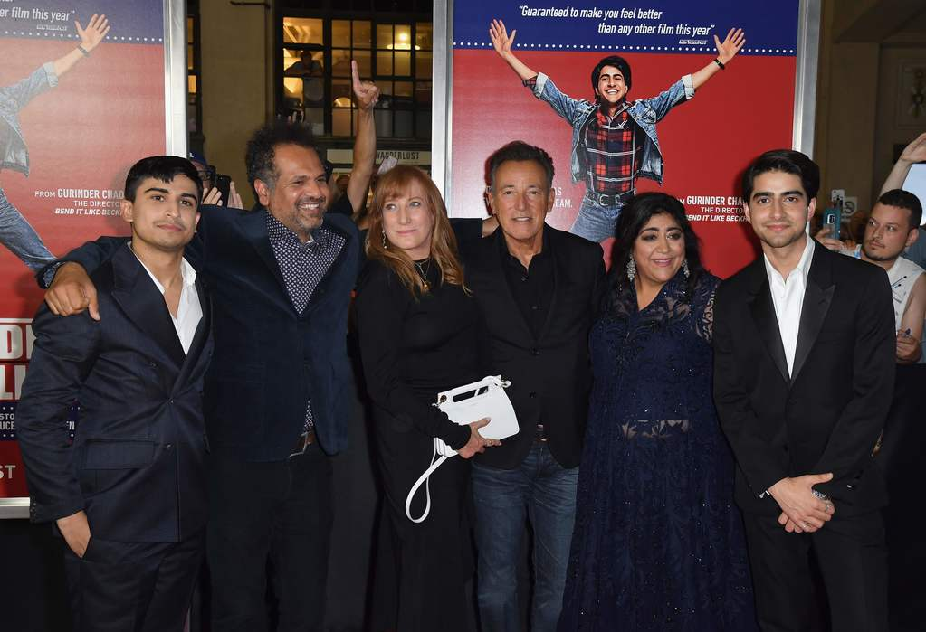 """Actor Aaron Phagura, British writer Sarfraz Manzoor, guitarist Patti Scialfa with her husband singer-songwriter Bruce Springsteen, Director Gurinder Chadha and actor Viveik Kalra attend the premiere of """"Blinded by the Light"""" at Paramount Theater on August"""