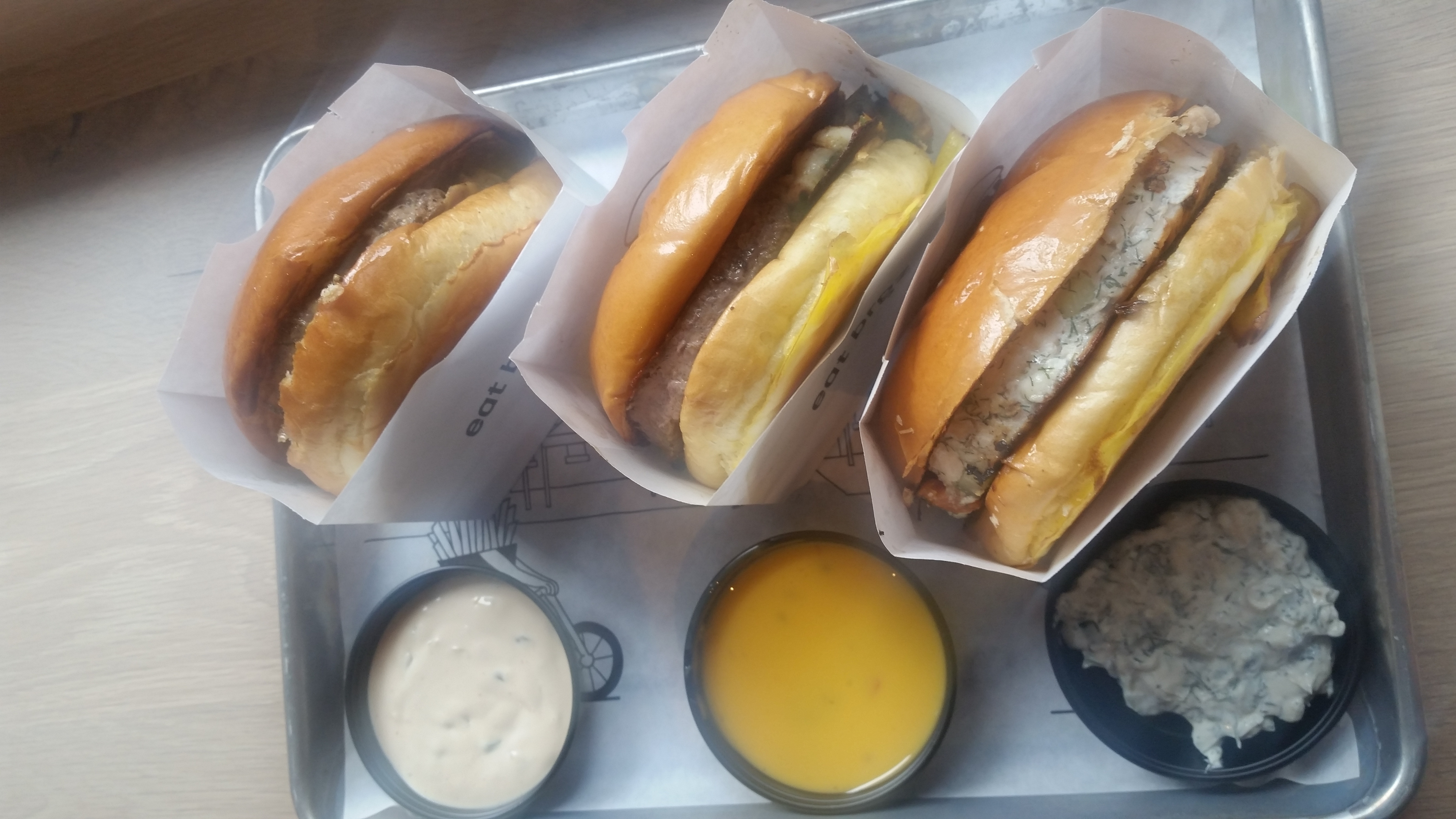 "A lineup of signature ""brgz"" including Basic, chorizo-laced La Burguesa, and the Greek"