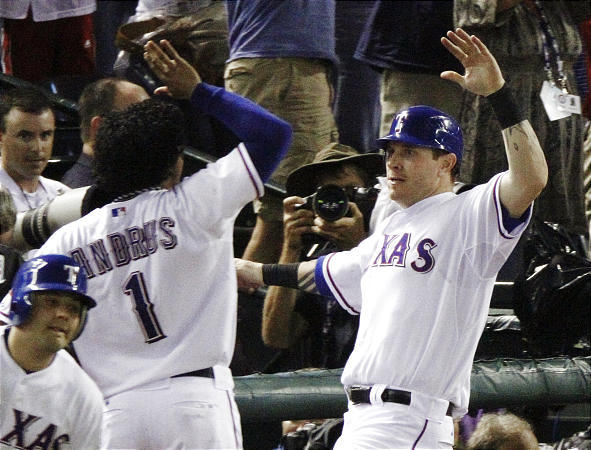 Texas Rangers' Josh Hamilton, right, celebrates with Elvis Andrus (1) after Hamilton scored on Vladimir Guerrero's two-run double.