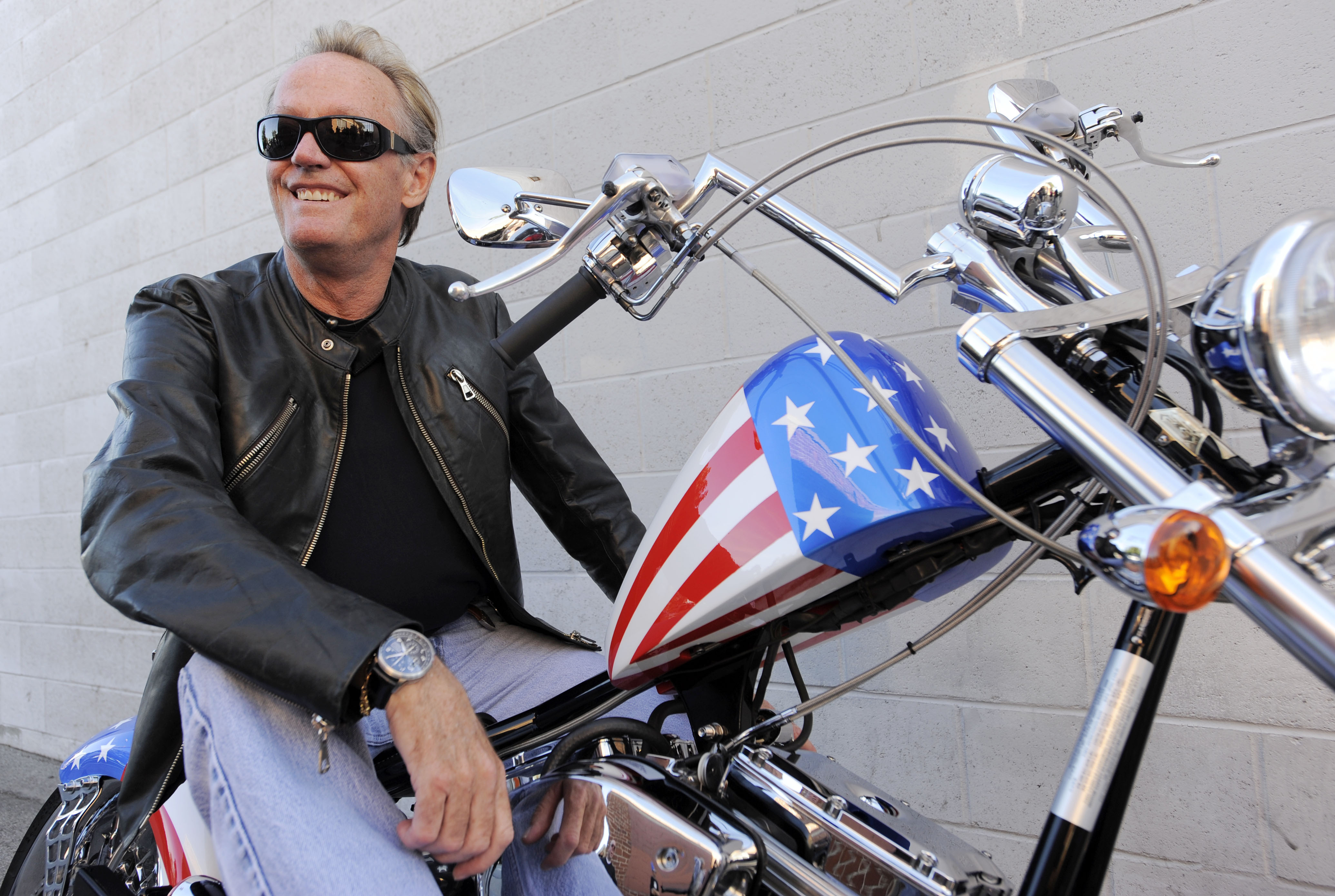 In this 2009 file photo, Peter Fonda poses atop a Harley-Davidson motorcycle in Glendale, California. The actor died Friday.