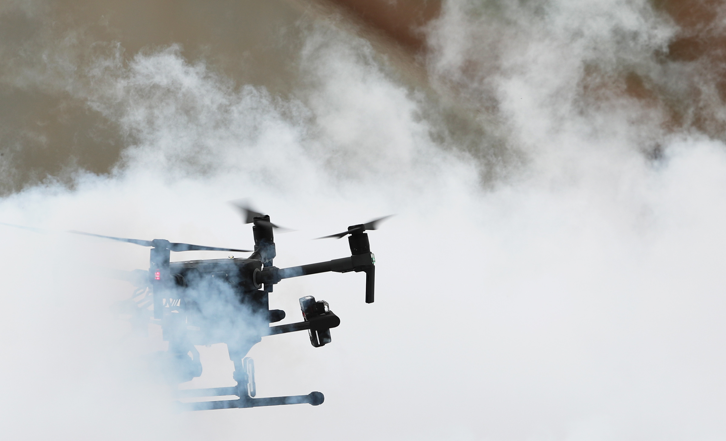 A drone hovers in a liquid nitrogen cloud during a demonstration as Deseret UAS group hosts a two day workshop on deploying drones in hazardous materials situations for emergency responders at the Tekoi Test Range on the Goshute Skull Valley Reservation on Tuesday, June 25, 2019.