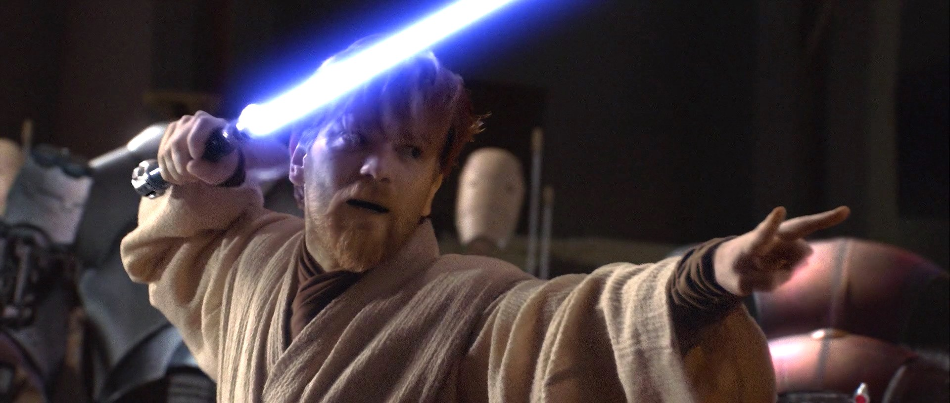 Obi-Wan Kenobi (Ewan McGregor) stands in a fighting position with his lightsaber in the air as he prepares to battle General Grevious in Revenge of the Sith.