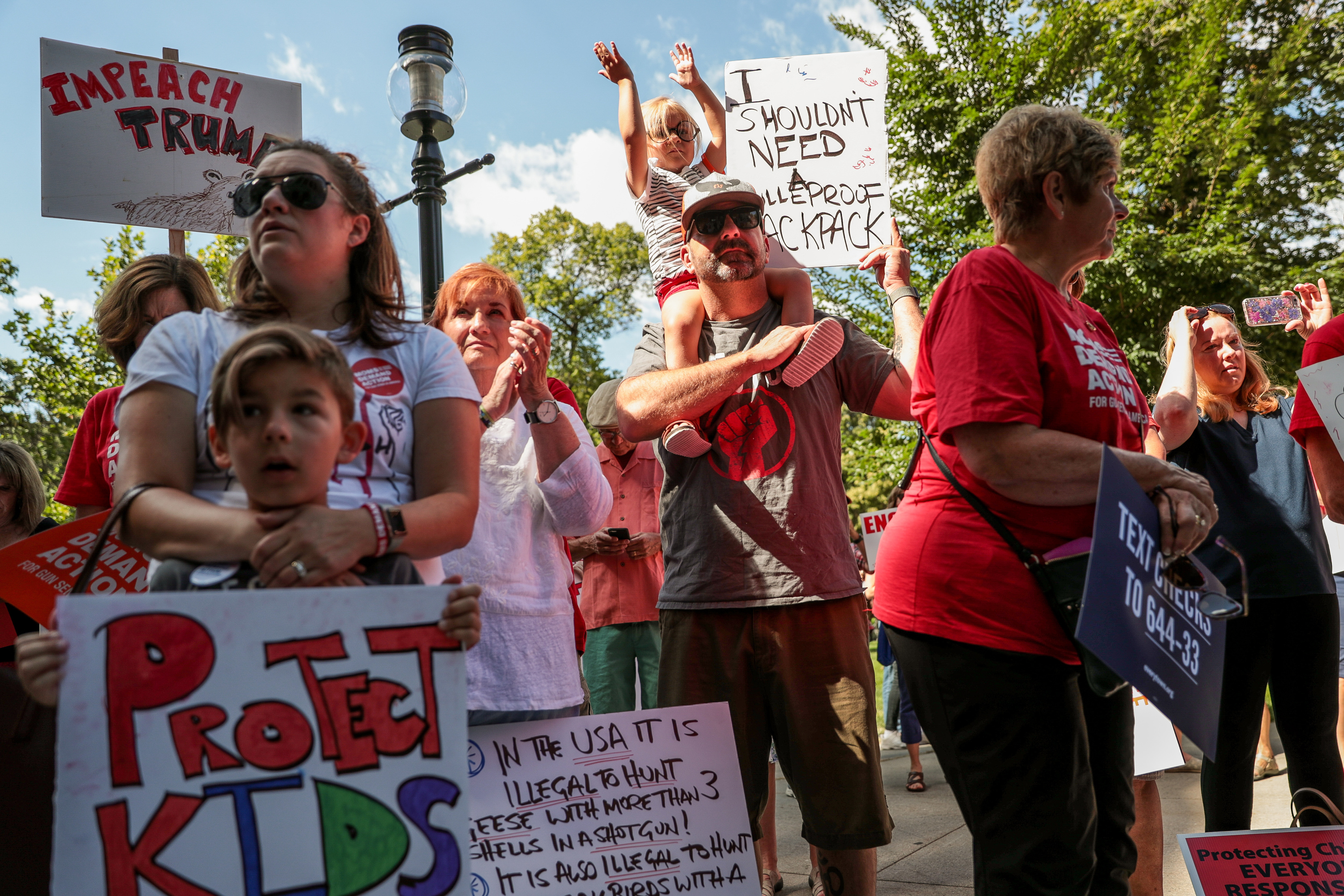 Matt Hewitt, of Sandy, holds his daughter, Elliott, 3, on his shoulders while attending a rally for stronger gun control laws at the Salt Lake City-County Building in Salt Lake City on Saturday, Aug. 17, 2019. At left is Hewitt's wife, Hillary, their son, Van, 6, and Hillary's mother, Cheryl Call.